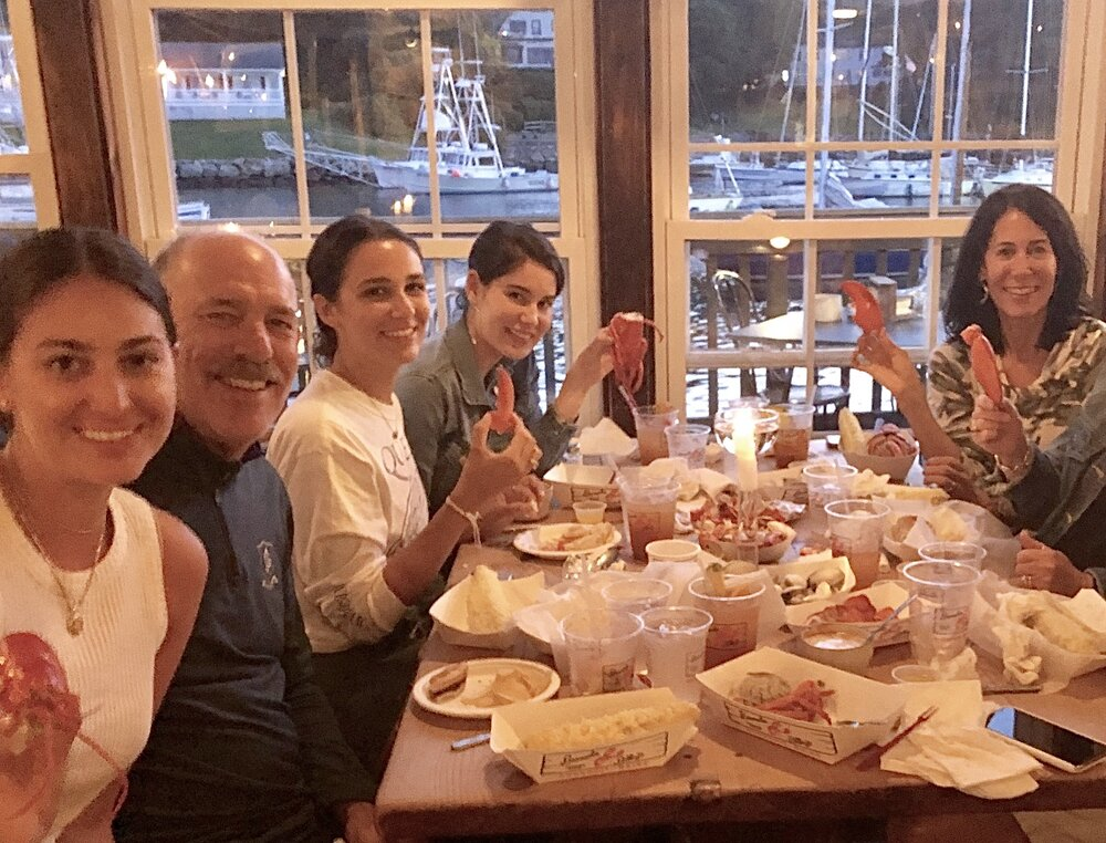 The author and her family enjoying Maine lobster during better days.