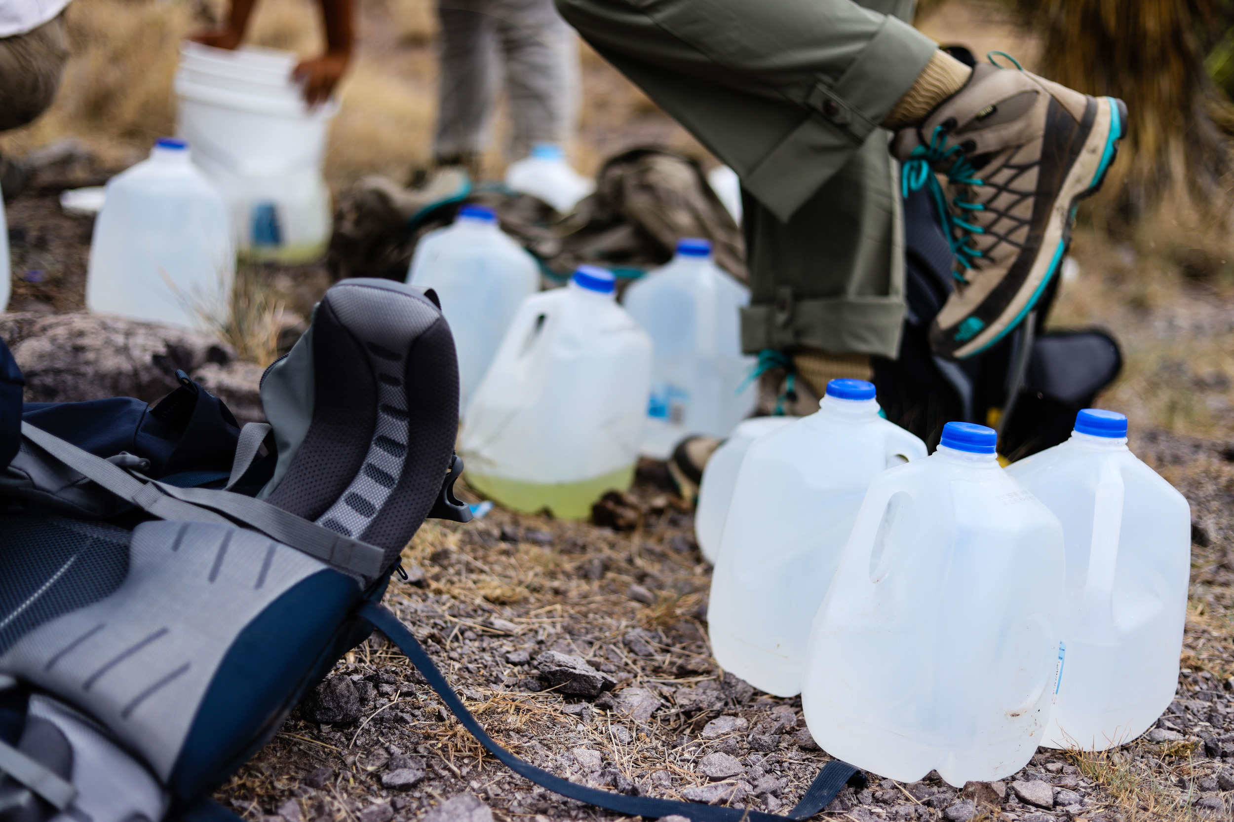 Water canisters are counted, and the empty ones are collected for reuse or disposal.