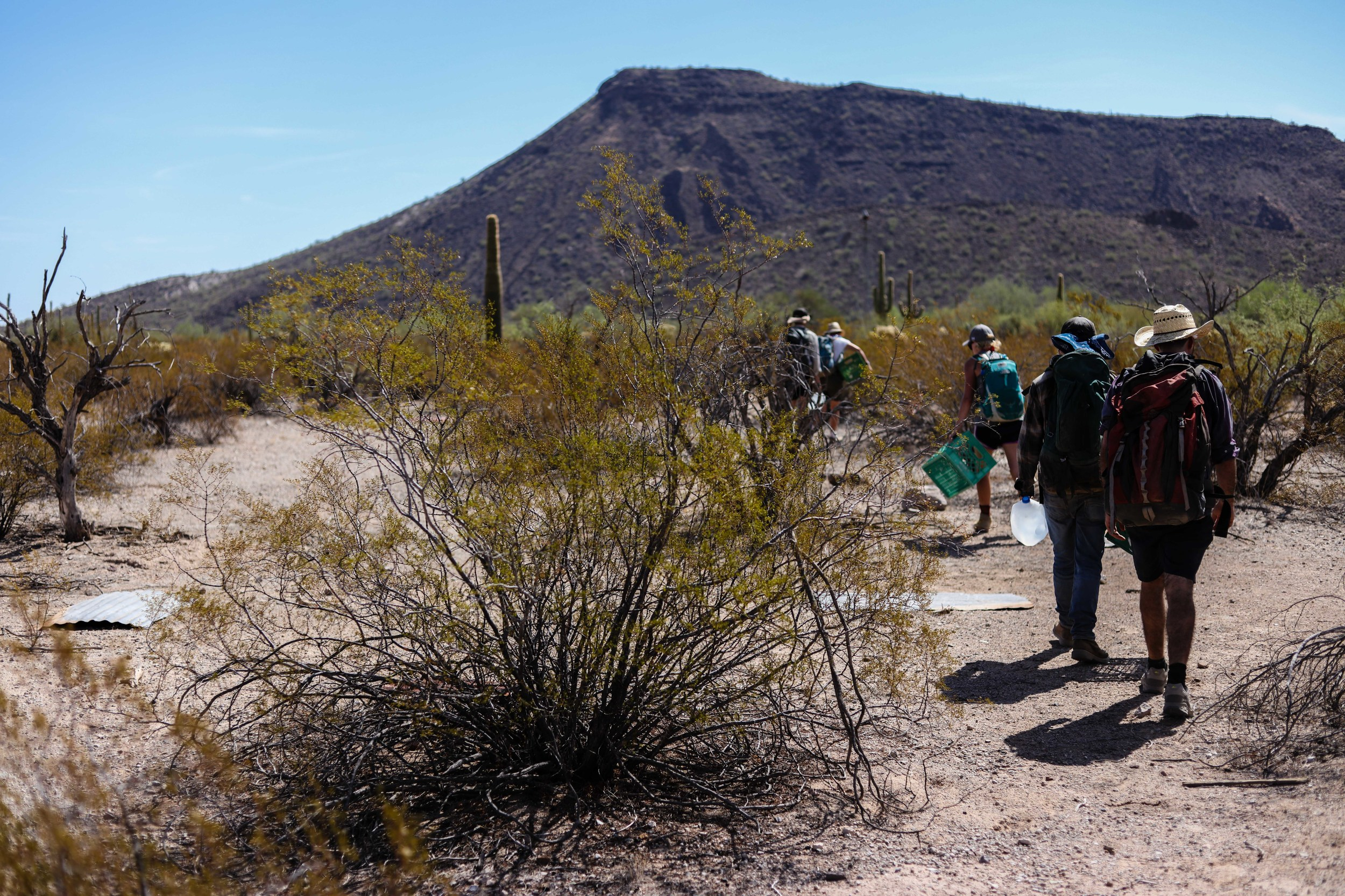 No More Deaths coordinates volunteers in teams. Each team consists of at least one Spanish speaker, one medically trained individual, as well as support members. The team aspect is essential to the work No More Deaths does, as the heat and terrain can make the work exceedingly dangerous.