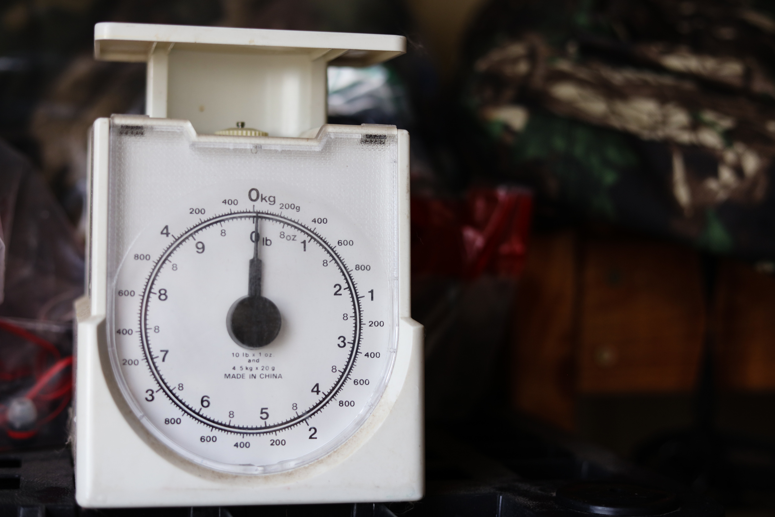 A scale is used to weigh belongings before they are shipped to families and migrants.