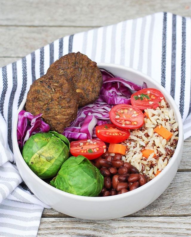 Nutrient packed Nourish bowl made with quinoa, carrot, brown rice, black beans, red cabbage, tomato, herbs, Brussels sprouts and @bitemefinefoods organic Wild Rice Falafels!🙌🏼🙌🏼 . . . . . . . . . #vegan #wholefoods #organic #veganfood #rawtill4 #rawfood #nourish #nutrition #healthyfoodshare #veggies #glutenfree #dairyfree #veganfoodshare #foodie #foodisfuel #vegansofig #superfood  #falafel #sugarfree #veganfoodshare #jerf #feedfeed #food52 #onmytable #healthy #eats #cleaneating #cleaneats #veganremcipes #vegansofinstagram #plantbased