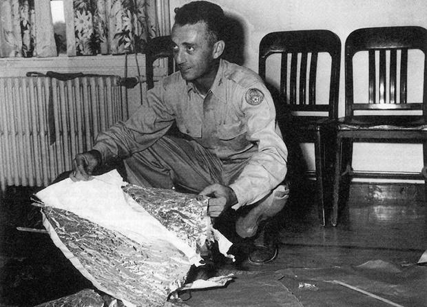 Jesse Marcel inspects the debris in Gen. Brig. Ramey's office
