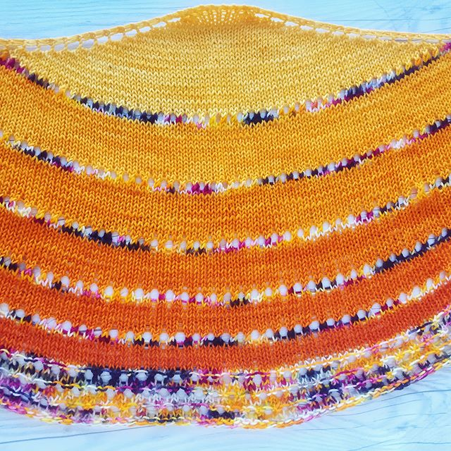 """All finished my first FLOTUS shawl! I can't wait to start the next💜 I changed the border a smidge (only 3 repeats) as my sister wanted it a bit smaller, and I really like it!! 💛🧡 Pattern: FLOTUS Shawl by @shannonsq  Yarn:  Victory Sock in """"Sleeveless"""" by @knittedwit 😳💛 #craftsposure #knittersofInstagram #knit #shareyourknits #knitlove #instaknit #creativelifehappylife #craftcolourmyday #abmlifeisbeautiful #abmcrafty #yarnlove #knittingaddict #craftastherapy #ourmakerlife #makersgonnamake #knitsharelove"""