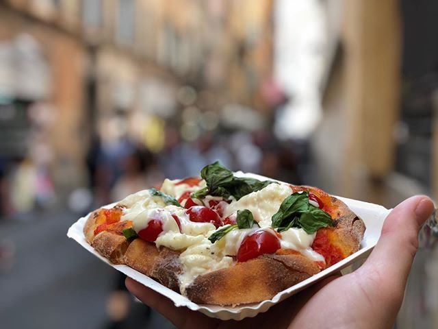"When in Rome do like the Romans do.. - Well considering that we were stopping in a few places through Italy that trying a little pizza in each would be a great treat.. - So a little ""Pizza Roma"" from a tiny little place near to the Pantheon did just the trick.. - Fresh Roma tomatoes, mozzarella de buffalo Burrata, basil, sauce and the best crust ever.. - So good and definitely worth eating while in Italy, and I'm from New York and if there's anything that NY'ers know, it's pizza..🍕🍕 • #yum #chefonthego #definitelydelish #tasty #foodtravel #travel #vacay #vacation #italia #italy #italianfood #italiancuisine #delish #pizza #mozzarella #goodeats #rome #traveleats #eatsonthego #pizzaholiday #roma #romapizza #myfoodtravel"