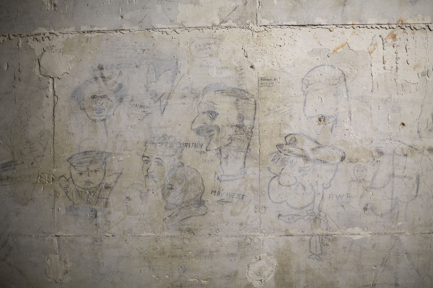 WWII-era drawings on the wall show the cave's history as a munitions depot