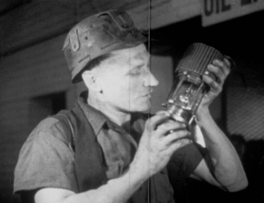 Melodic Miner adjusting his condenser mic prior to blasting a seam.