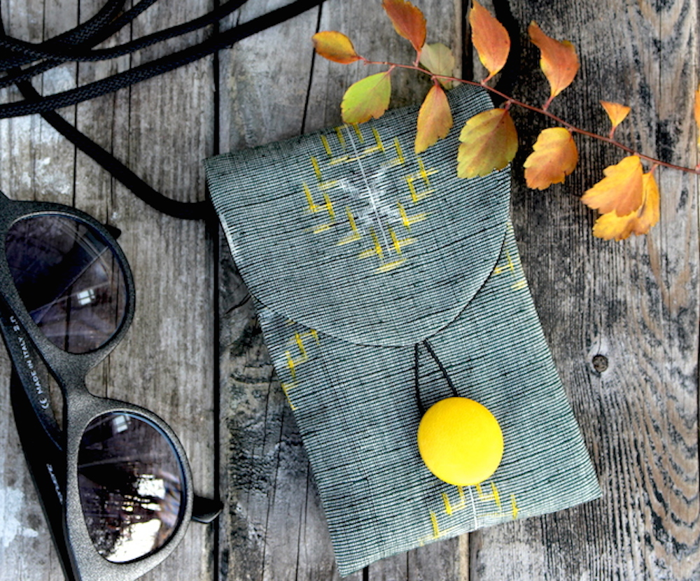 Kasuri dyed and handwoven silk from a vintage kimono offers subtlety in this mini purse