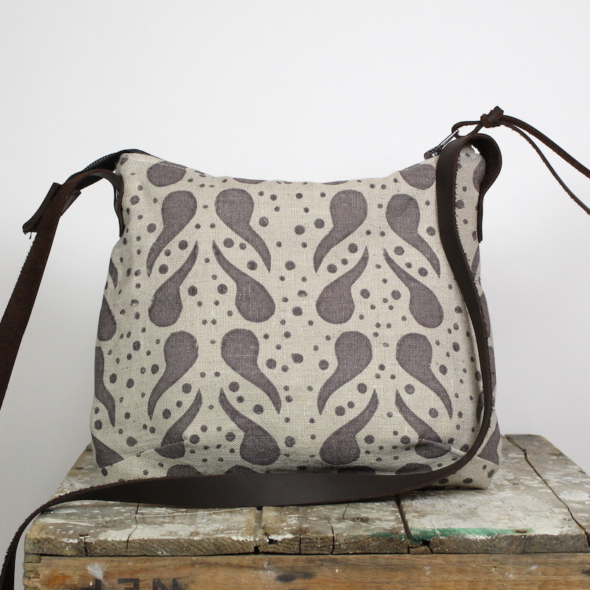 """""""Doris, the Day Bag"""" in linen with silk screened paisley design and a hand cut leather strap."""