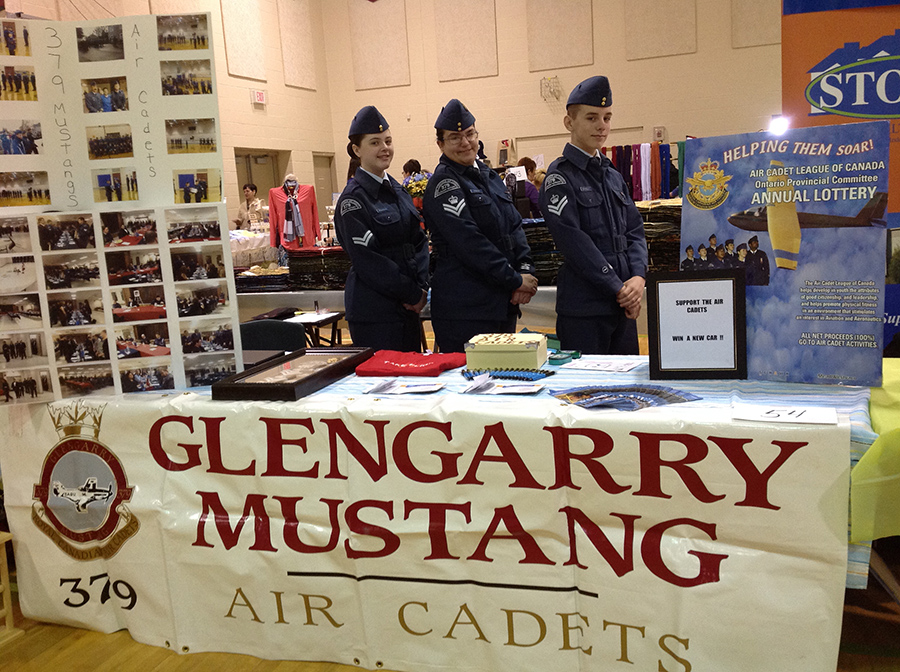 March 2014: Corporal Provencal and Flight Corporals Rimann and Donnelly in the 379 promo booth at Journée de la Femme/Women's Day.