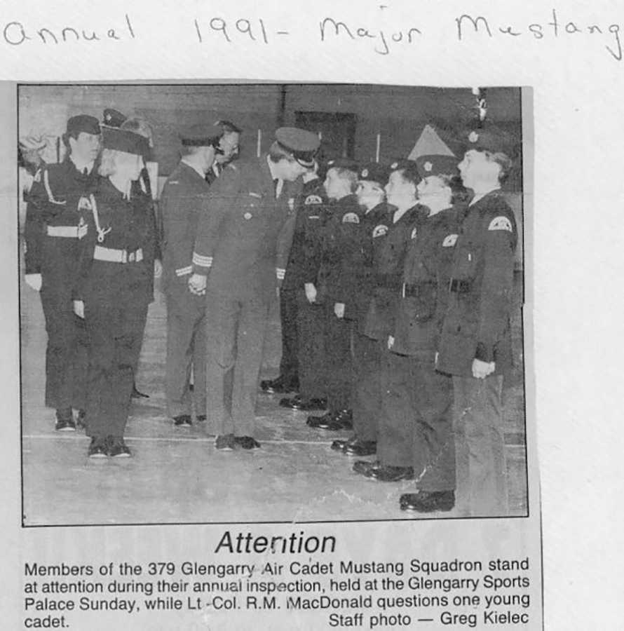 1991: Newspaper article on the Annual Parade. Major Mustang is the white horse with uniform hanging around in the office.