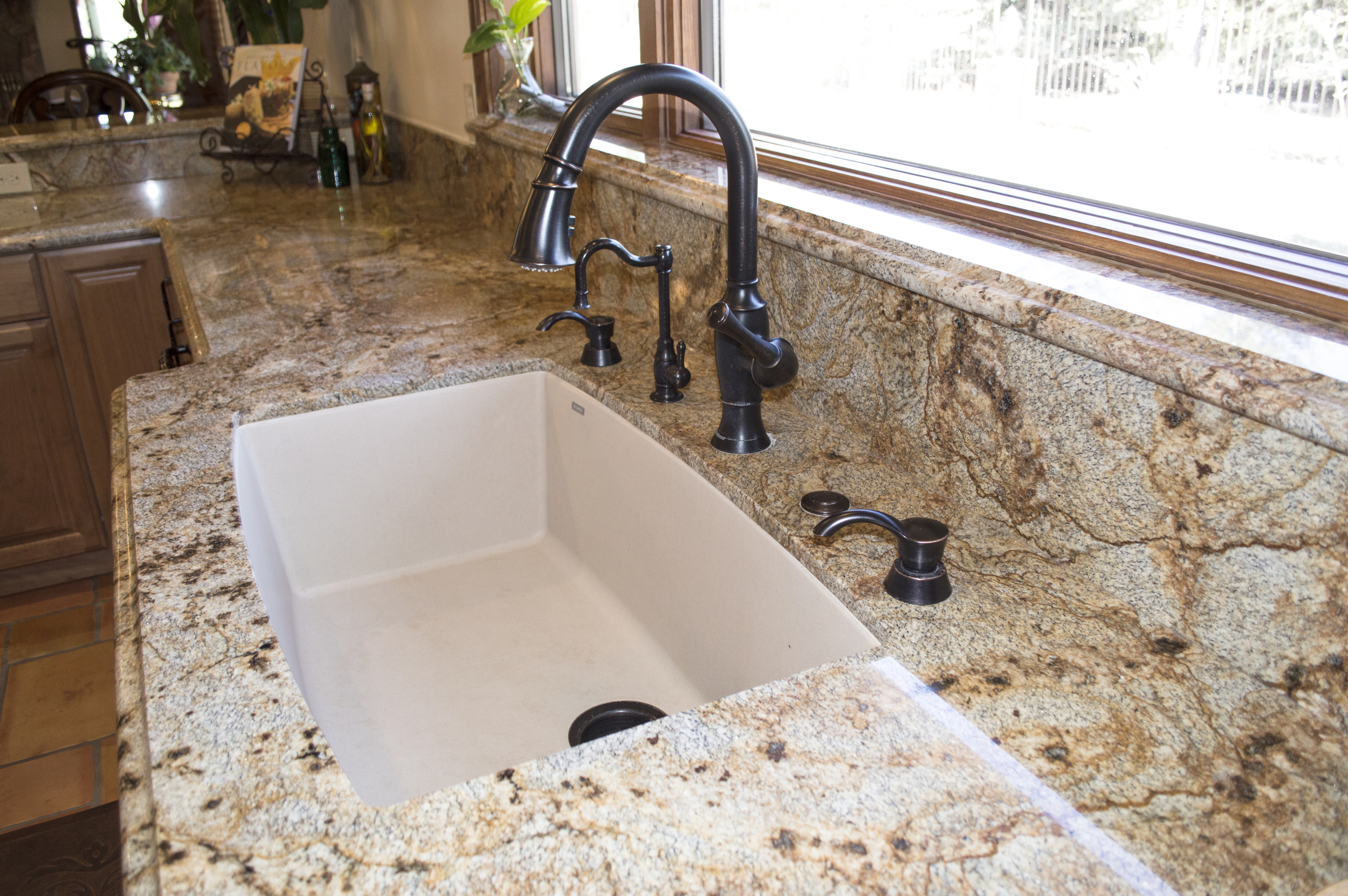 Sink in a completed custom kitchen in a residential home near Flagstaff, Arizona.