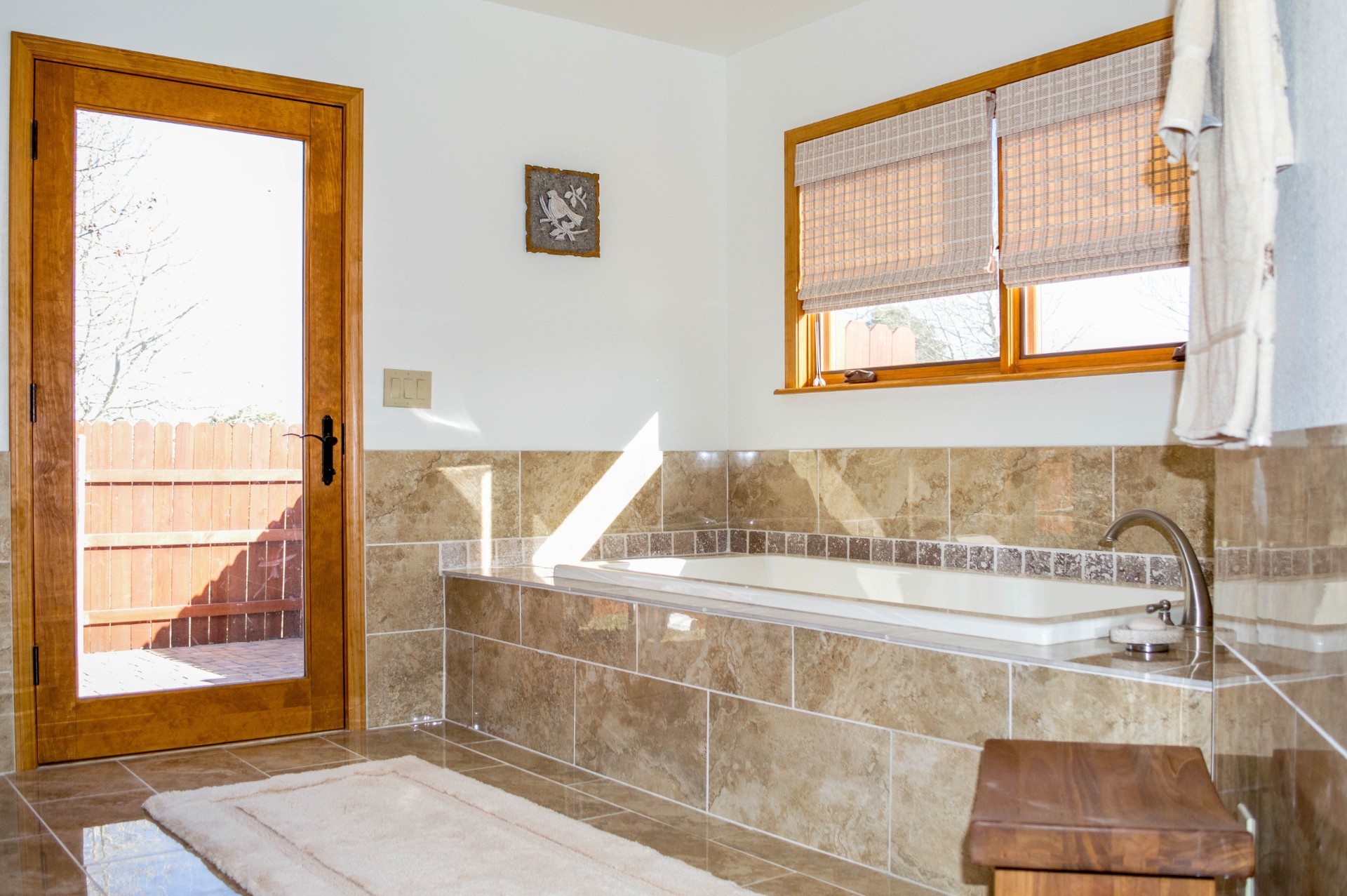 Completed bathtub and bathroom in a residential home.