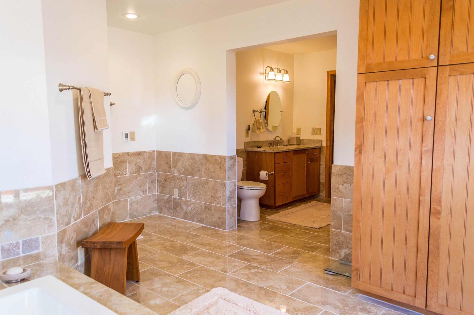 Completed custom bathroom and closet in a residential home.