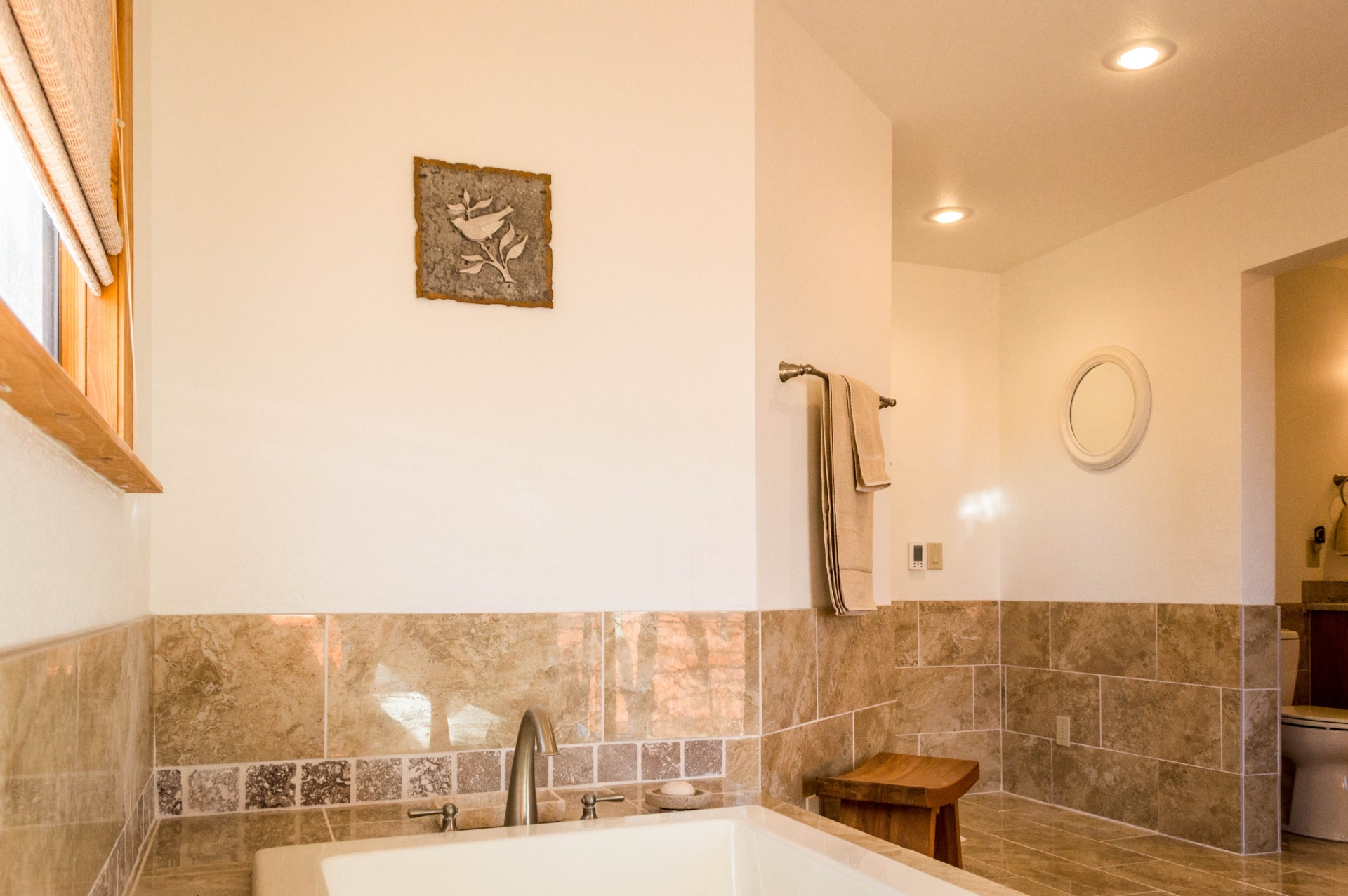 Completed bathroom with a custom bathtub.