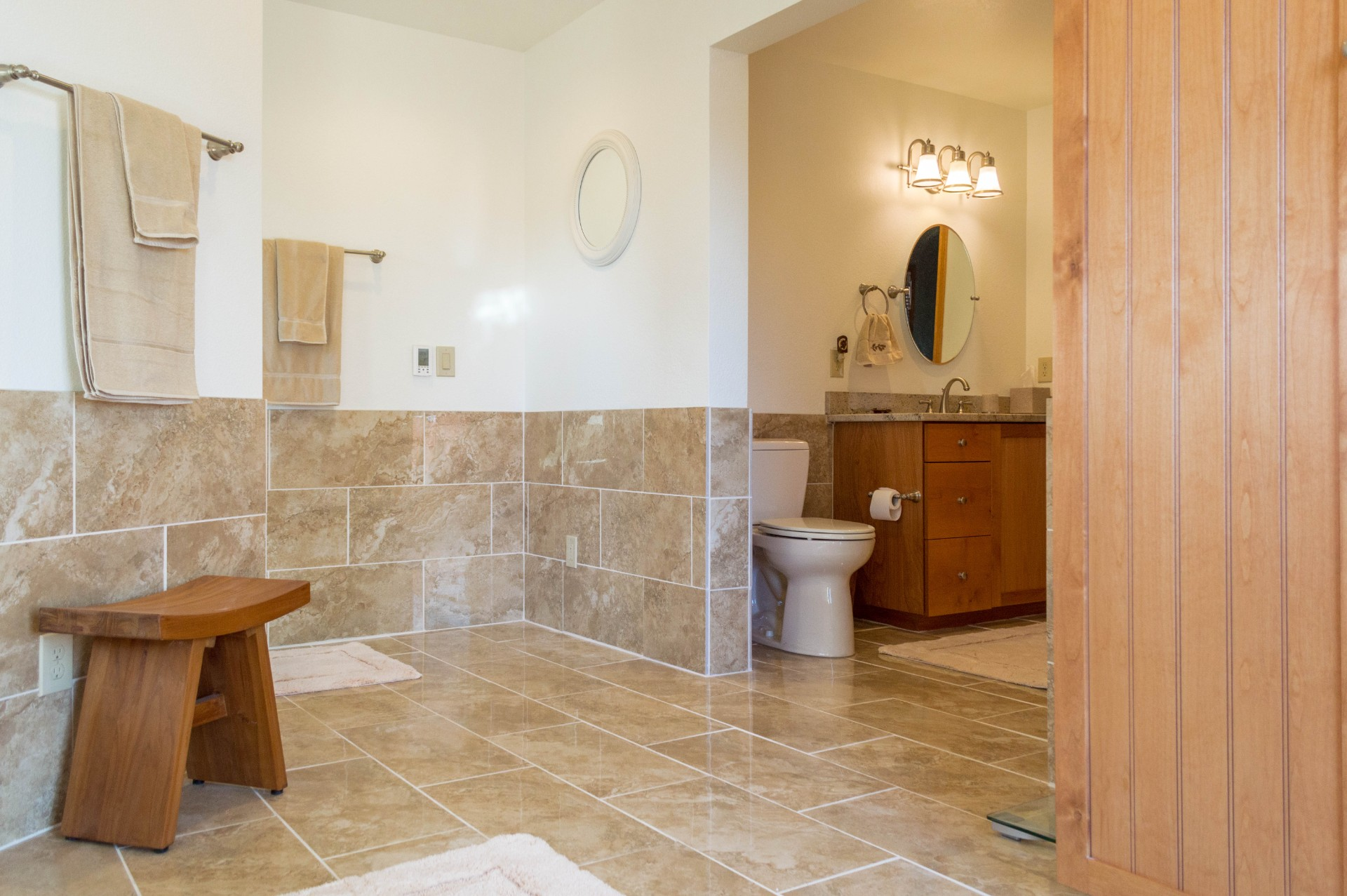 Completed bathroom and closet in a custom residential home.