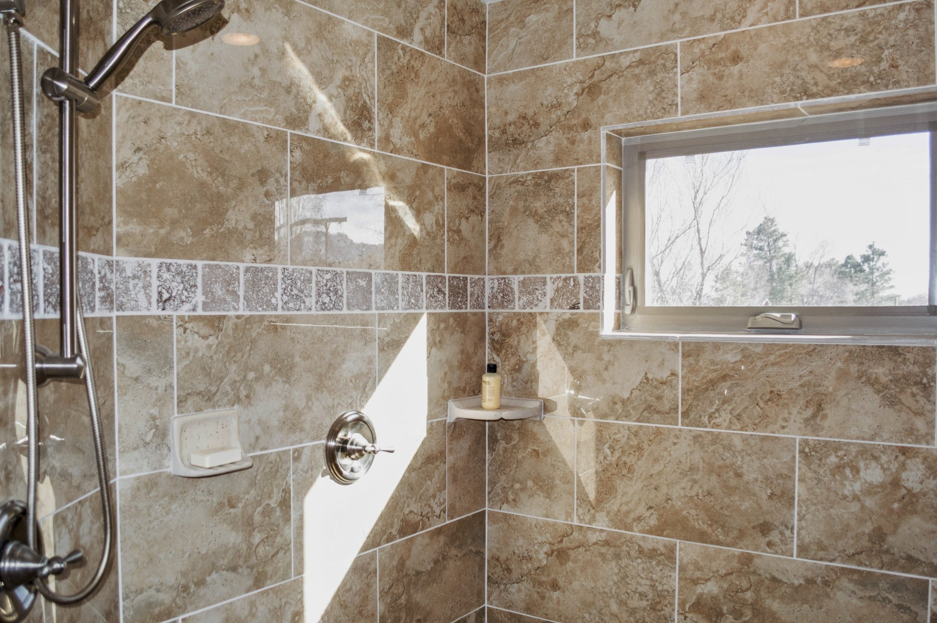 Completed shower in a custom bathroom of a residential home.