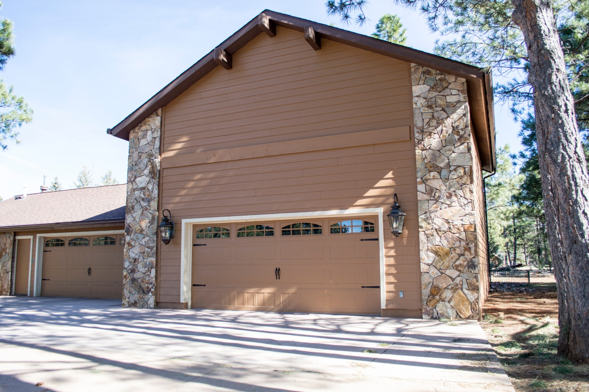 Completed garage outside of a custom residential home.