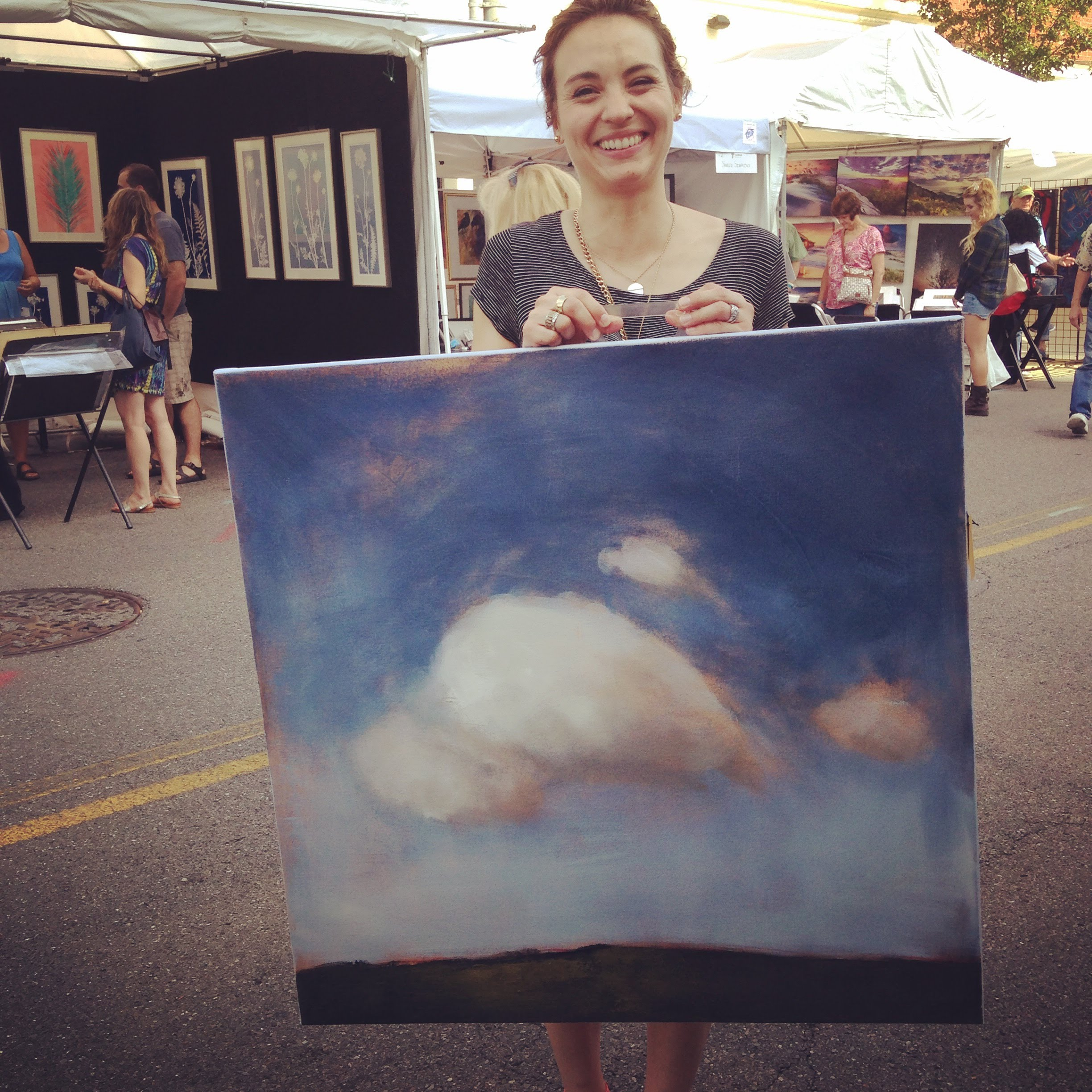 Delighted new Blue Sky Owner, Eliza, from the 58th Annual Taubman Museum of Art Sidewalk Art Show, June 2015