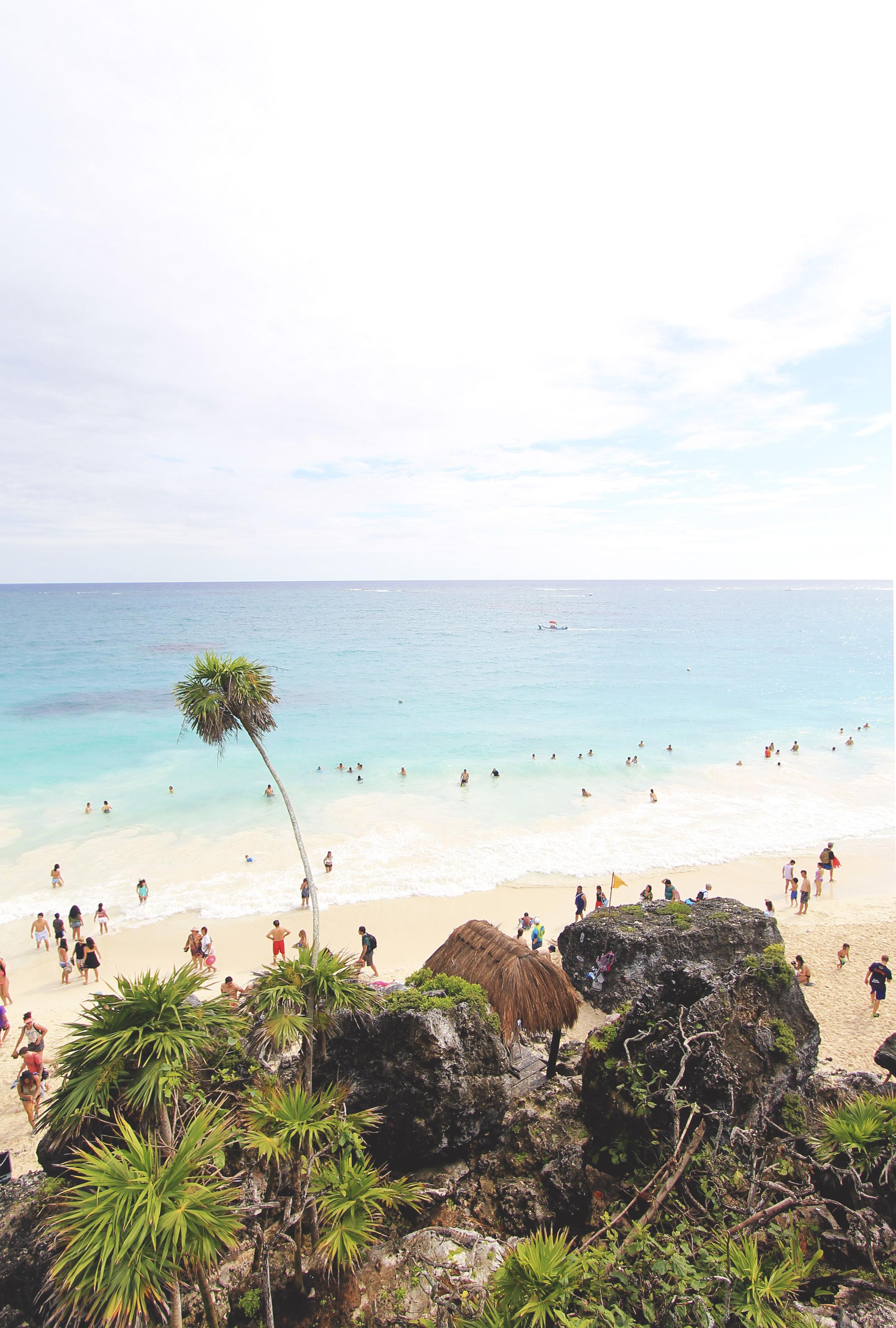 tulum sand beach ocean blue palm trees