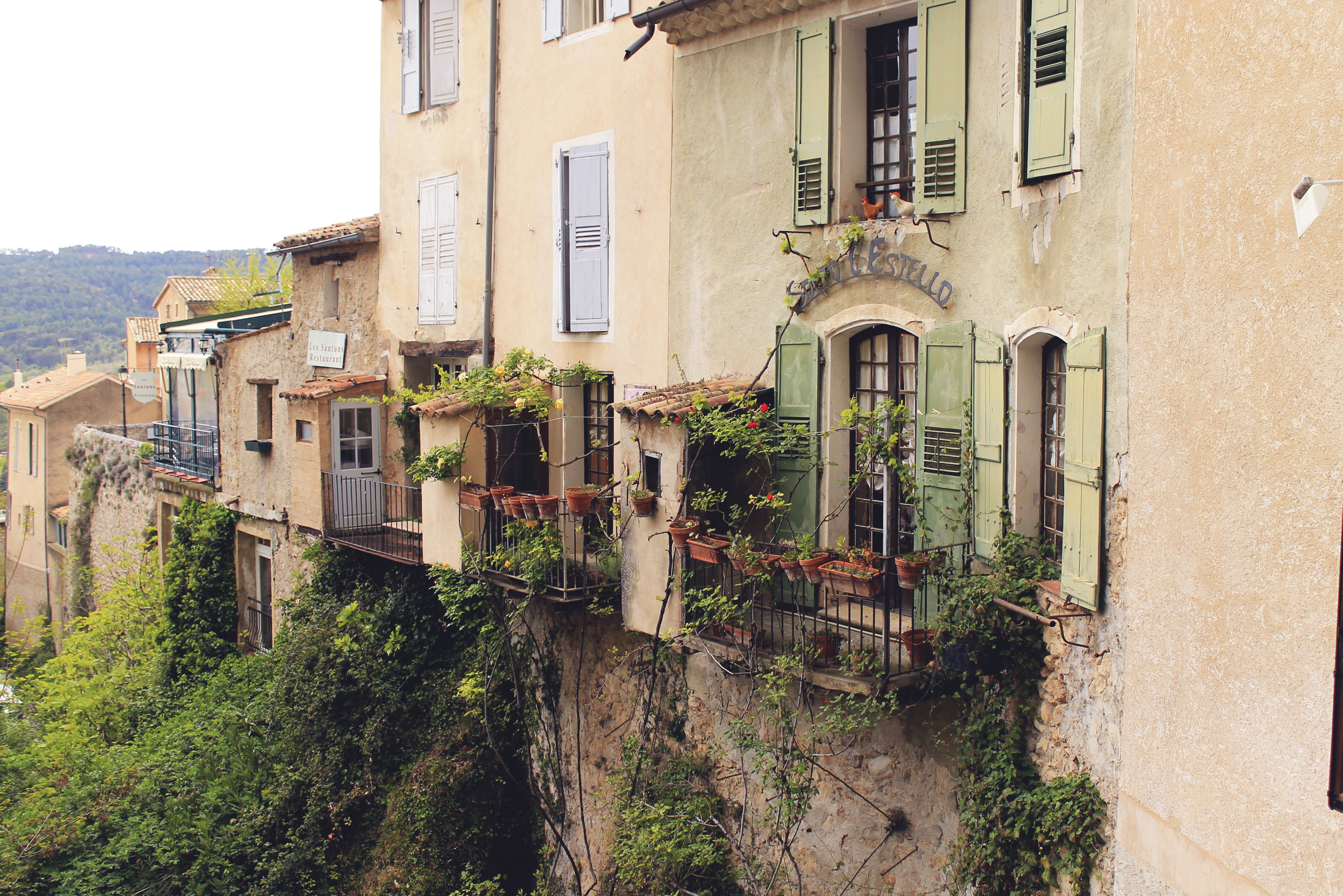 france hillside south cote d'azur town windowbox flowers