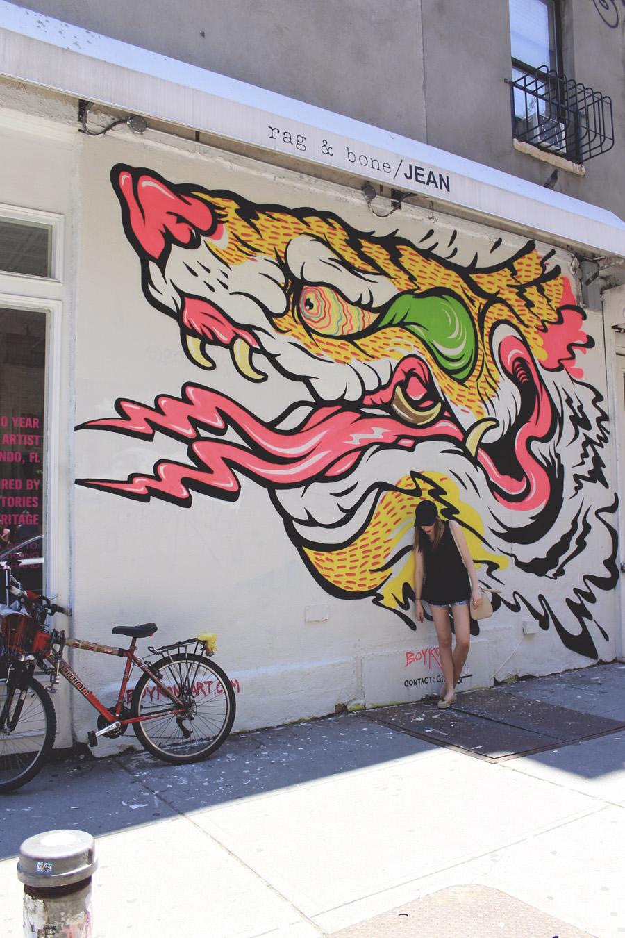nolita mural neon white summer new york city bike streets