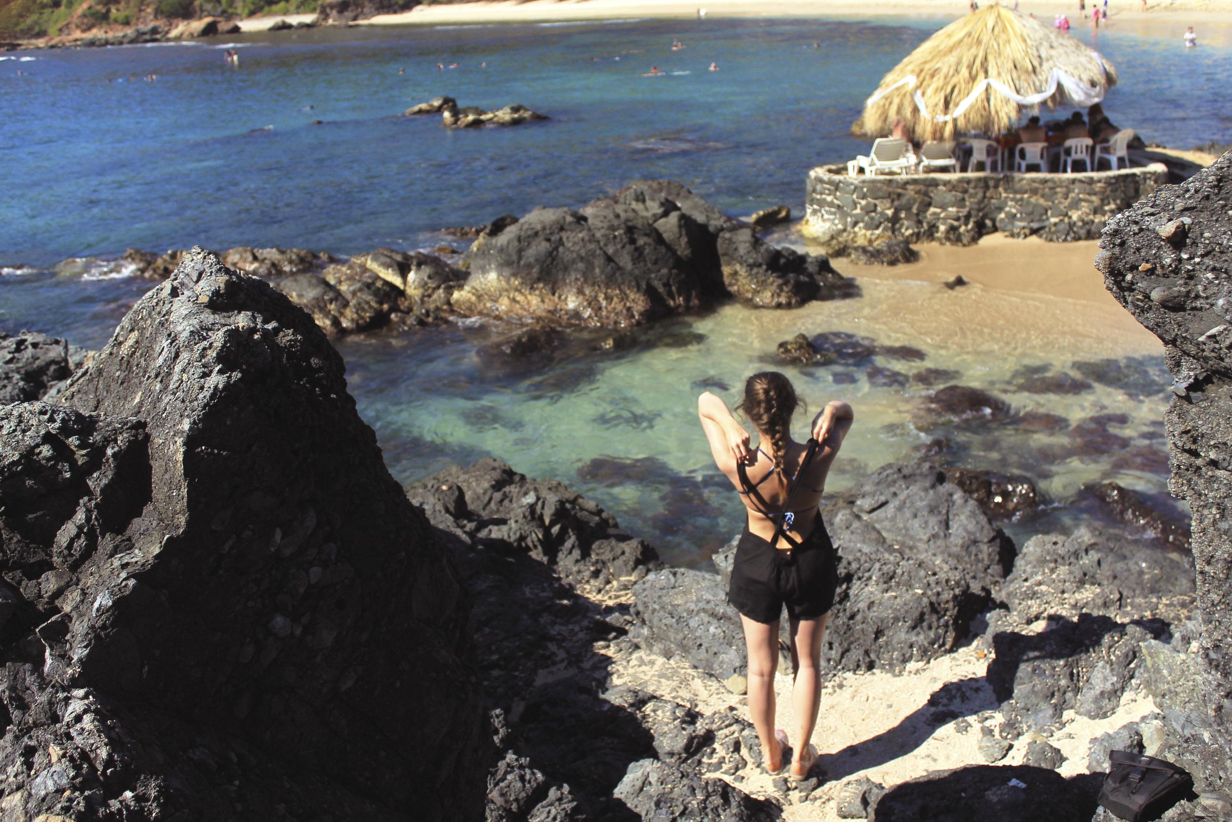 black overalls zara beach rocks mexico ixtapa