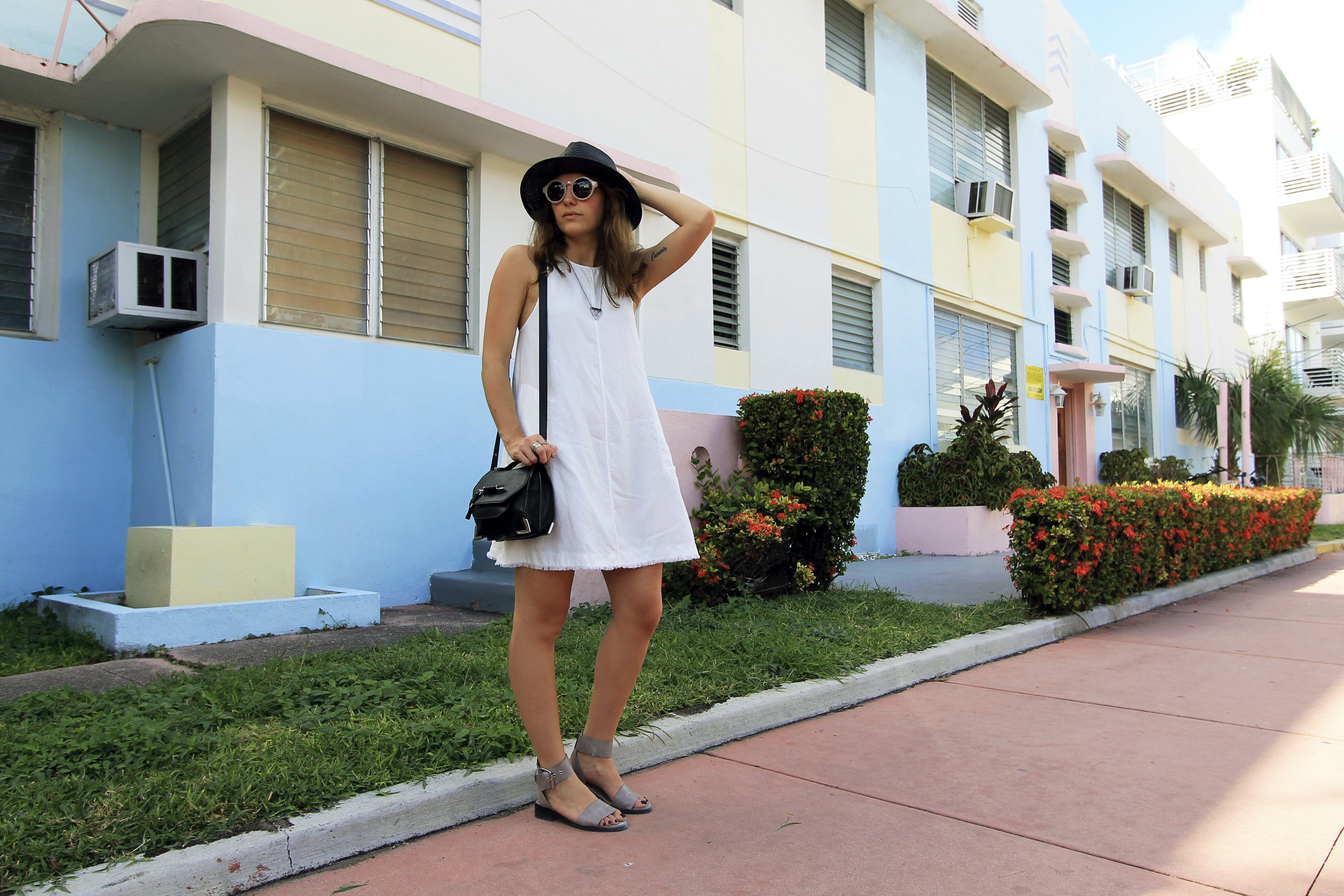 mackage ruby black arrow purse straw hat white linen dress grey two strap sandals.jpg