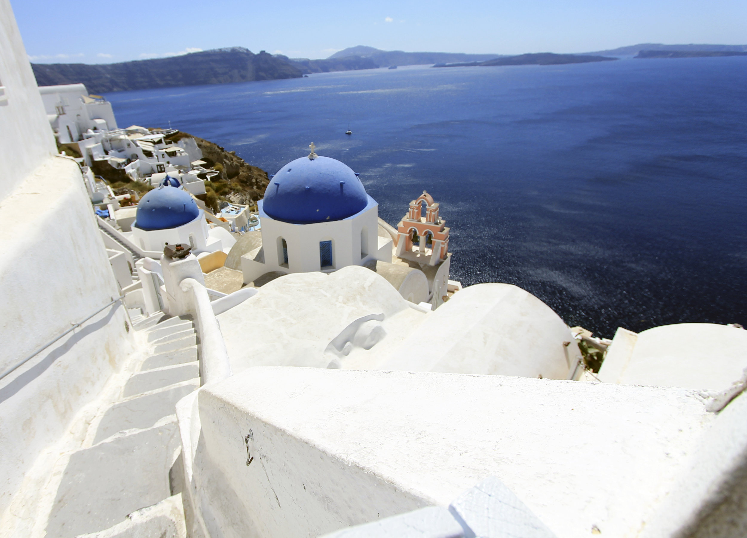 blue white church santorini dome stairs oia.jpg