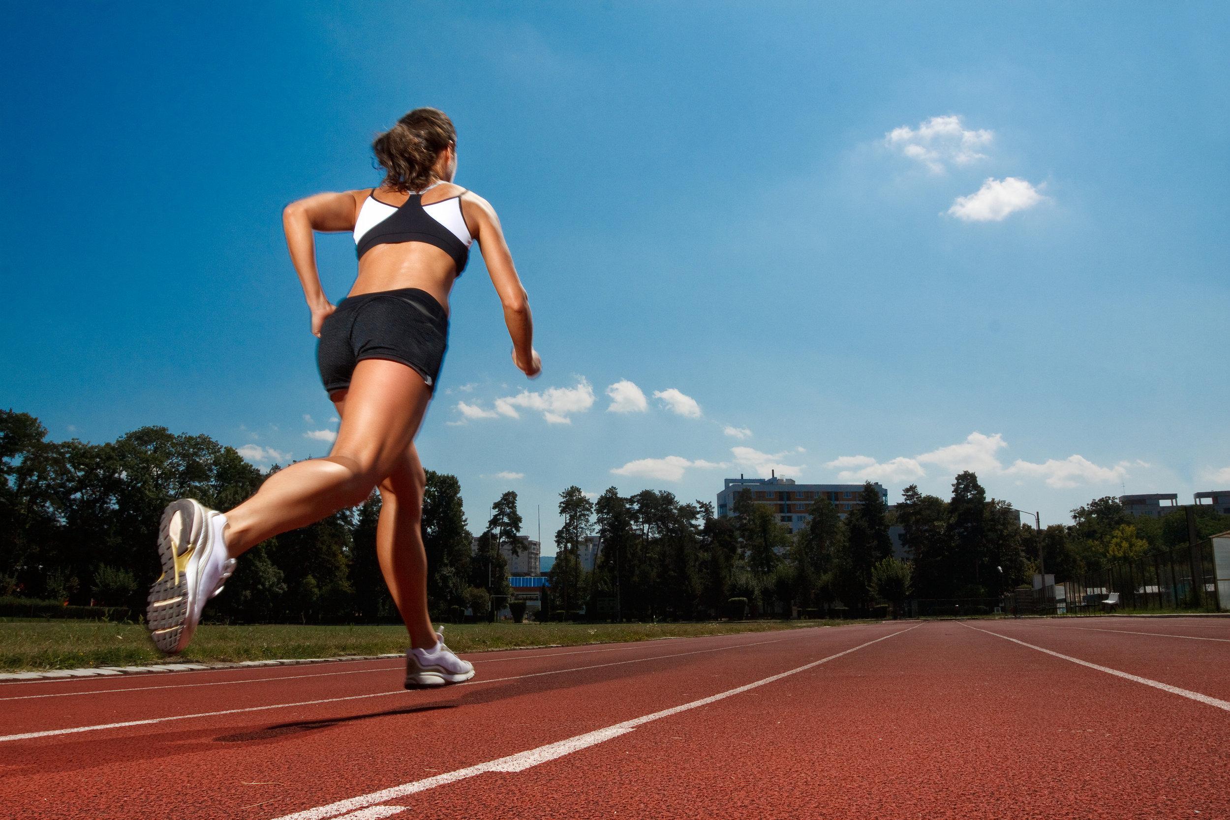 bigstock-Athletic-woman-running-on-trac-19463858.jpg