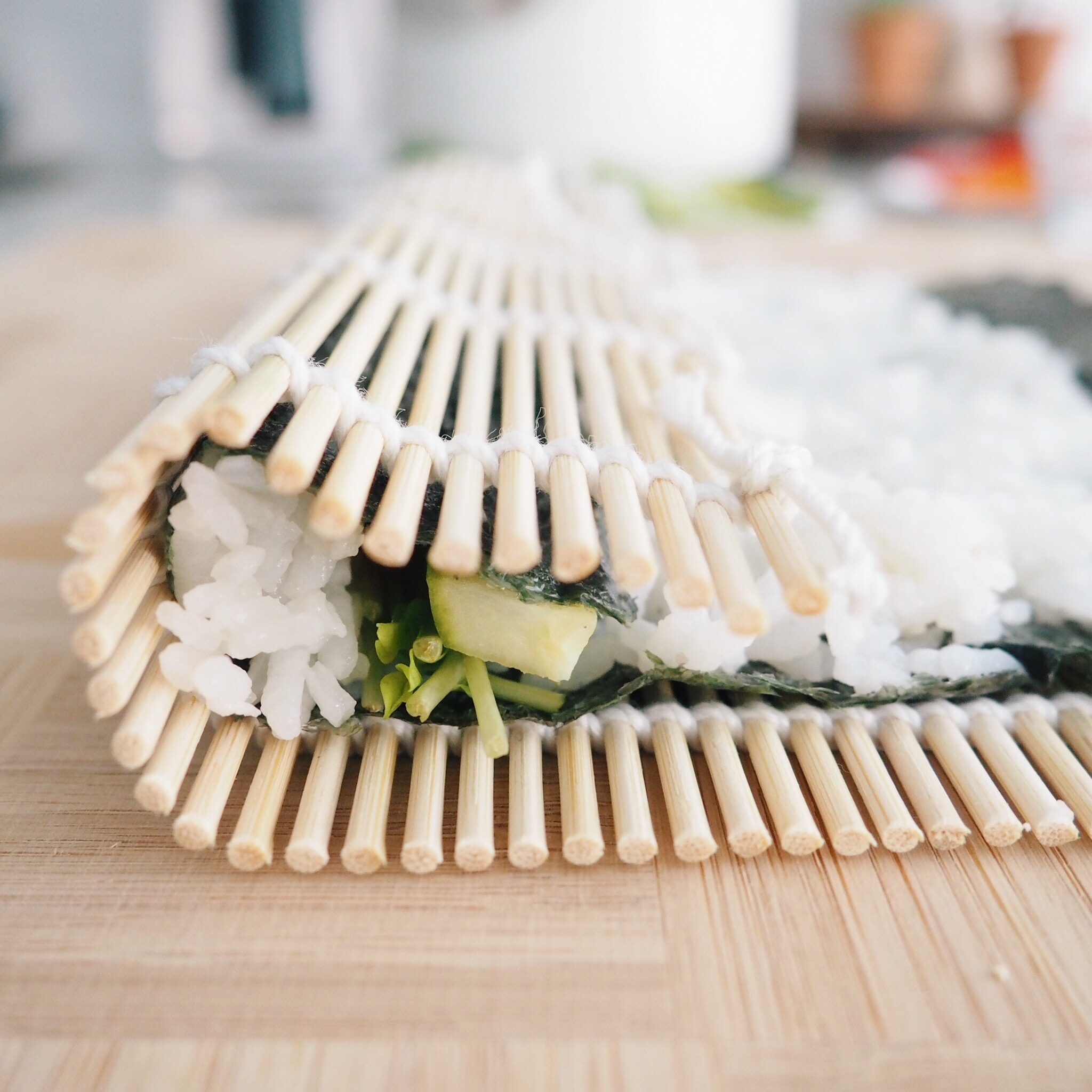 Step 4: Using the bamboo mat roller, tightly roll the vegetables in. This step is probably the most crucial to making your sushi look presentable.
