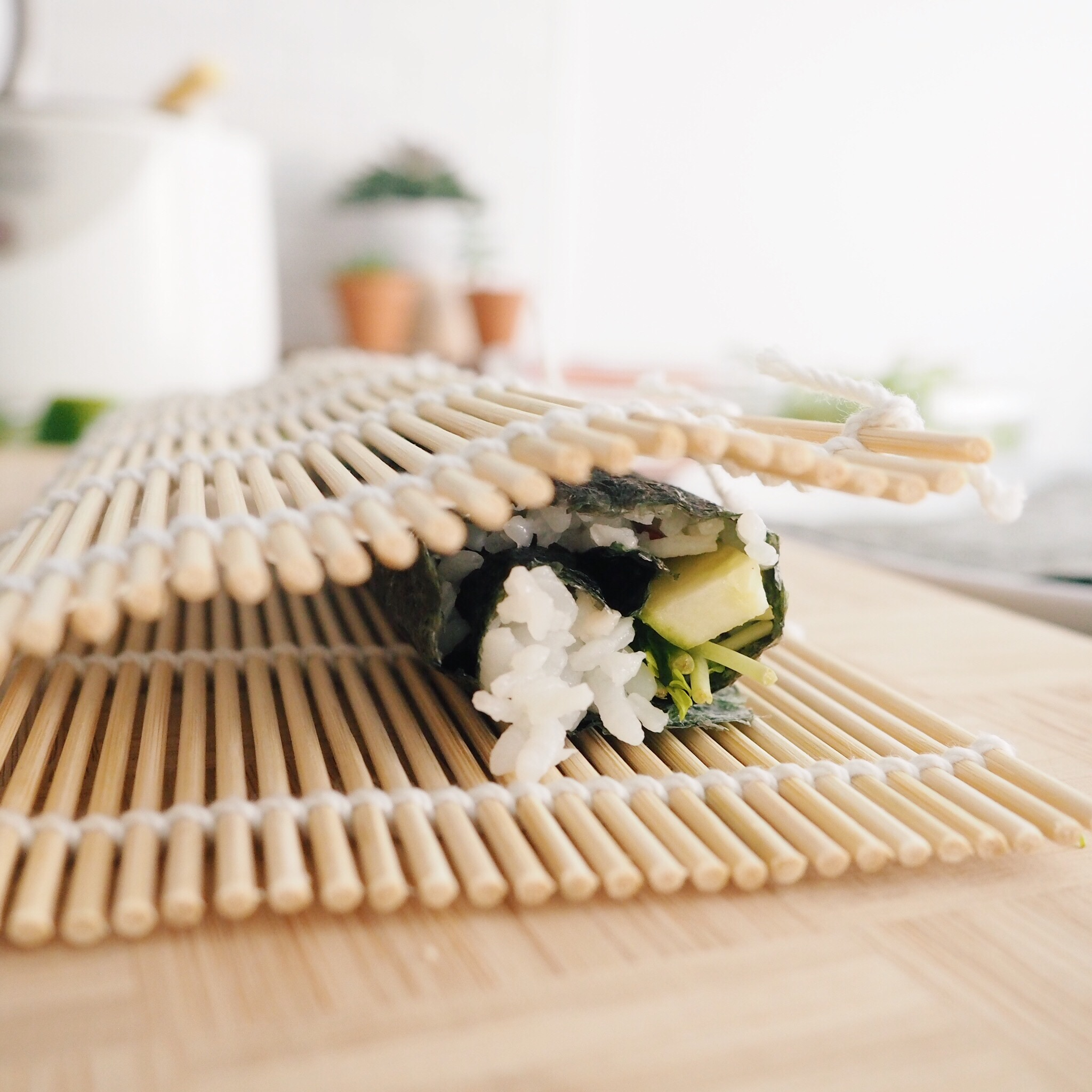 Step 5: Continue rolling until you reach the end. Using water or several rice granules, use it to help stick the seaweed flap against your roll for a tidy finish.
