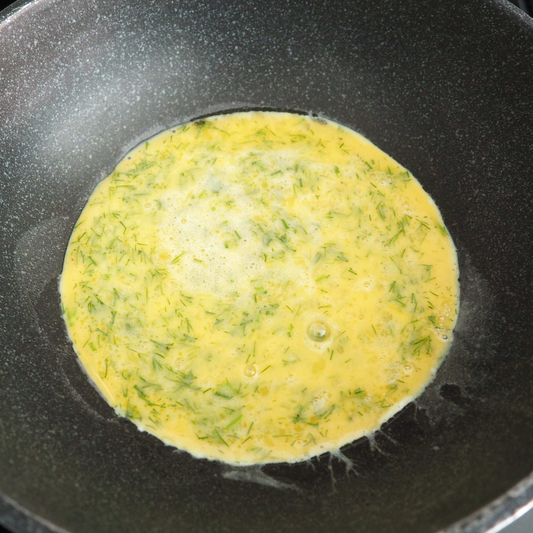 Step 3: On a pan set on medium heat, pour in your scrambled eggs