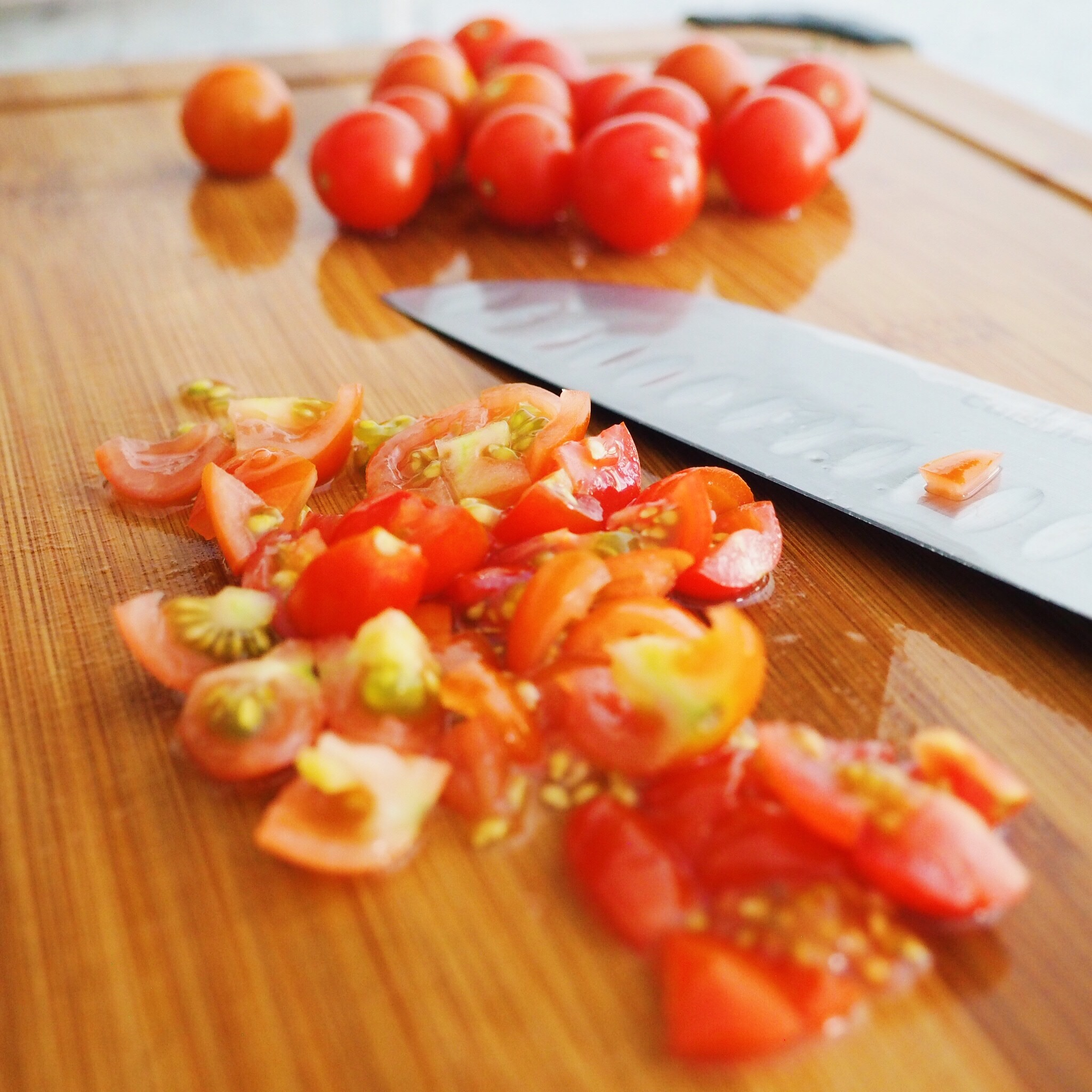 Step 8 - Meanwhile, finely chop your cherry tomatoes.