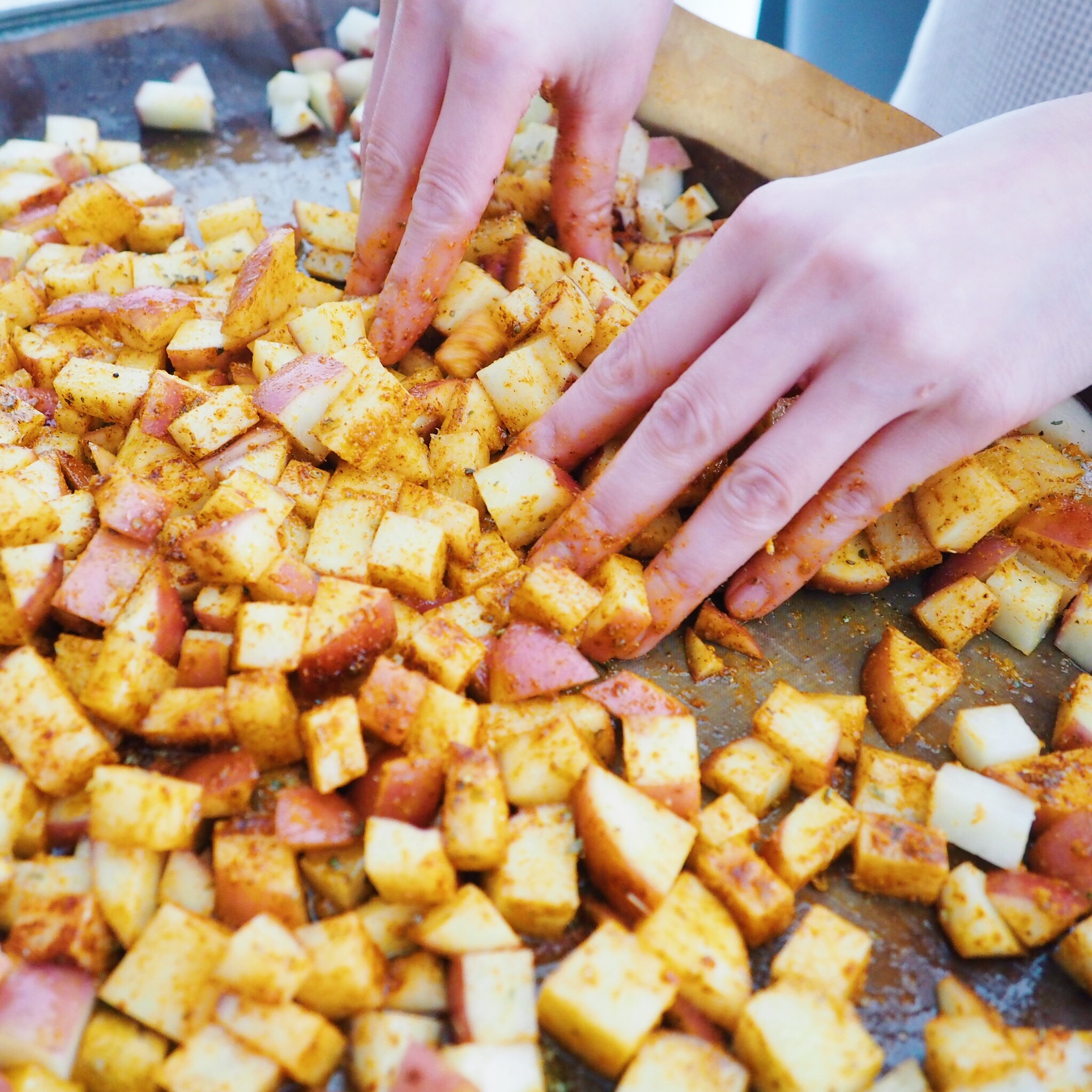 massage spices and oils into potatoes