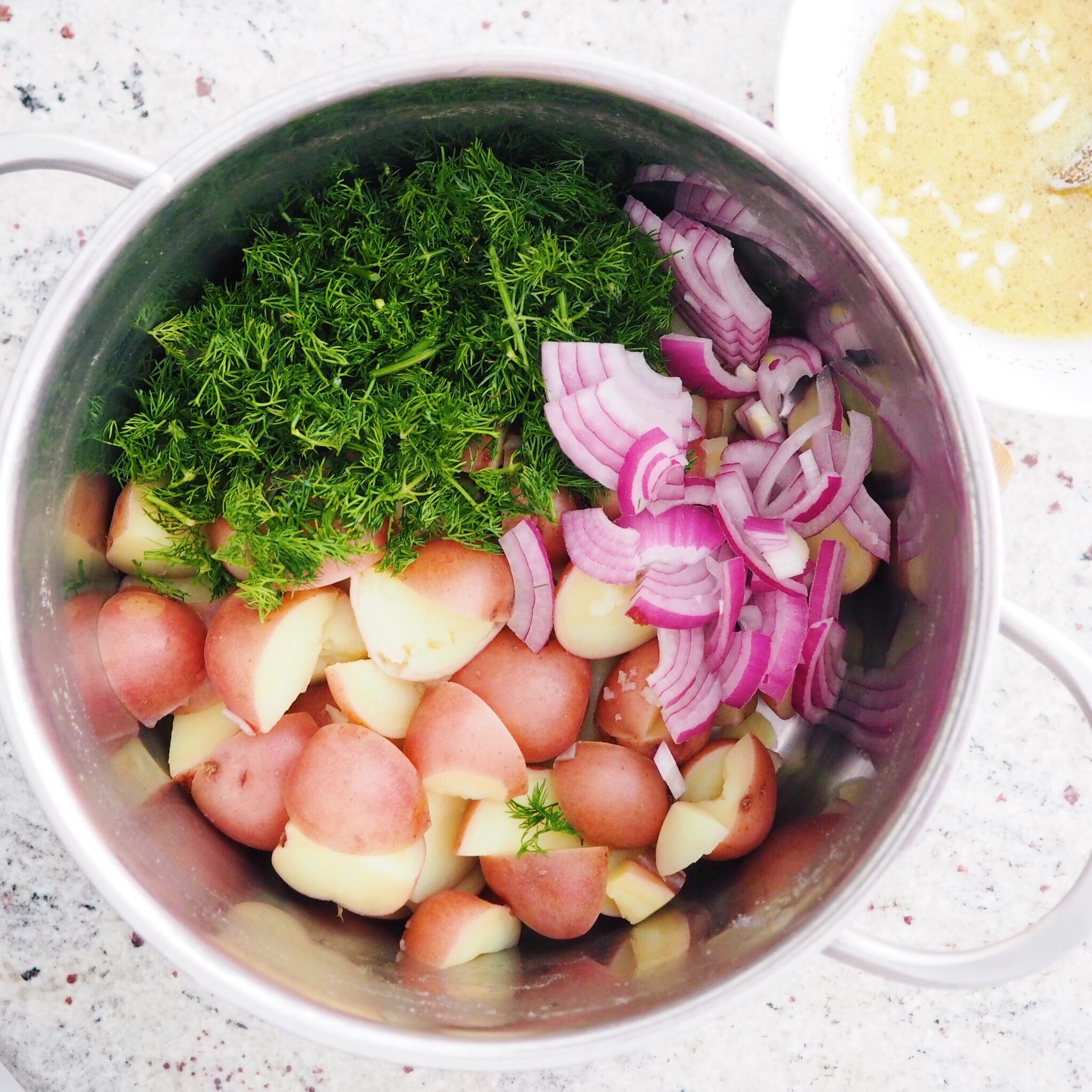 Step 6 - Into the same pot, add red onions, fresh dill and dressing ingredients