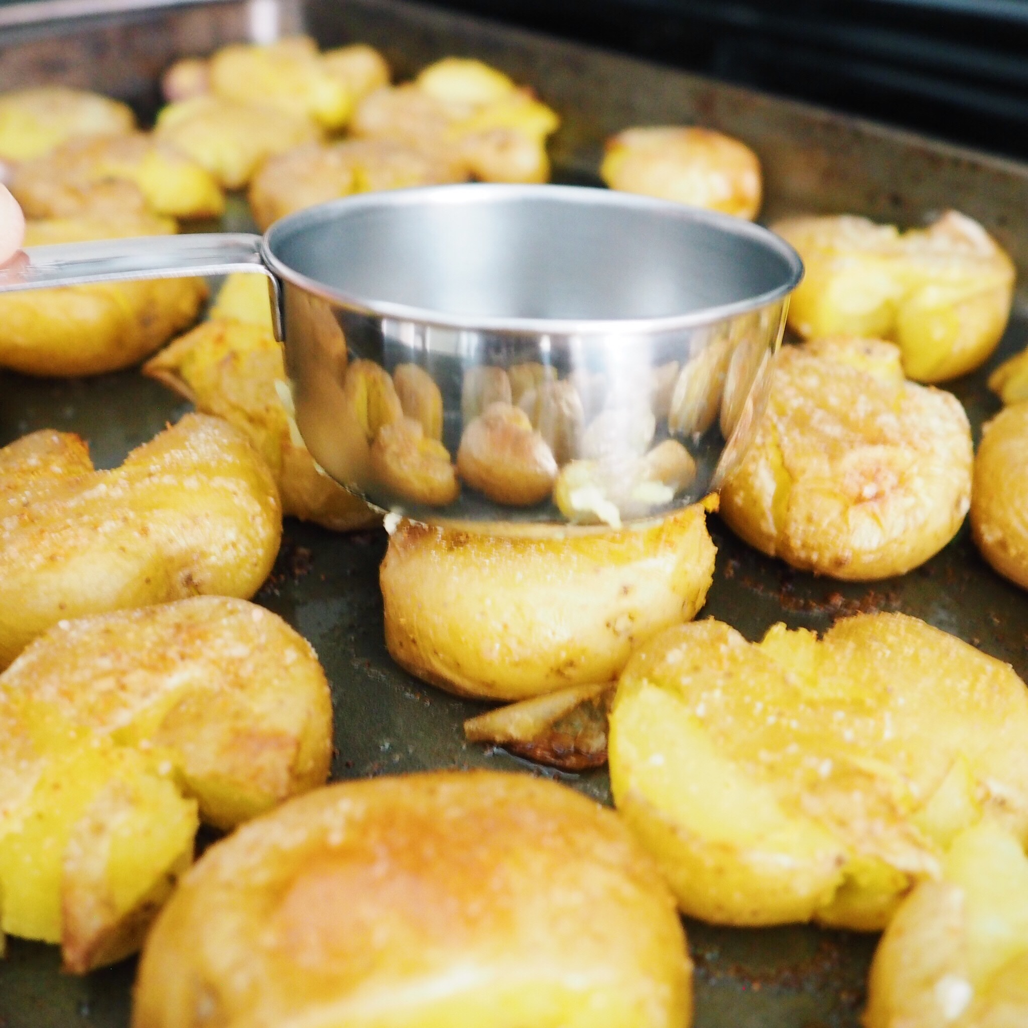 Step 10 - Flatten the potatoes again with measuring cup, creating more surface area for extra crisp. Bake for another 10 more minutes.