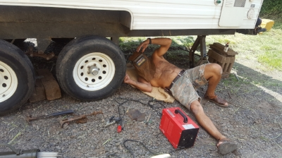 Jorge welding the lift spring on trailer.