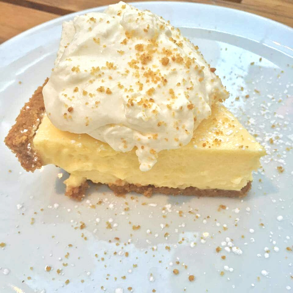 Key Lime Pie   - freshly squeezed key limes, graham cracker crust, hand whipped cream. Cost - $8.25.
