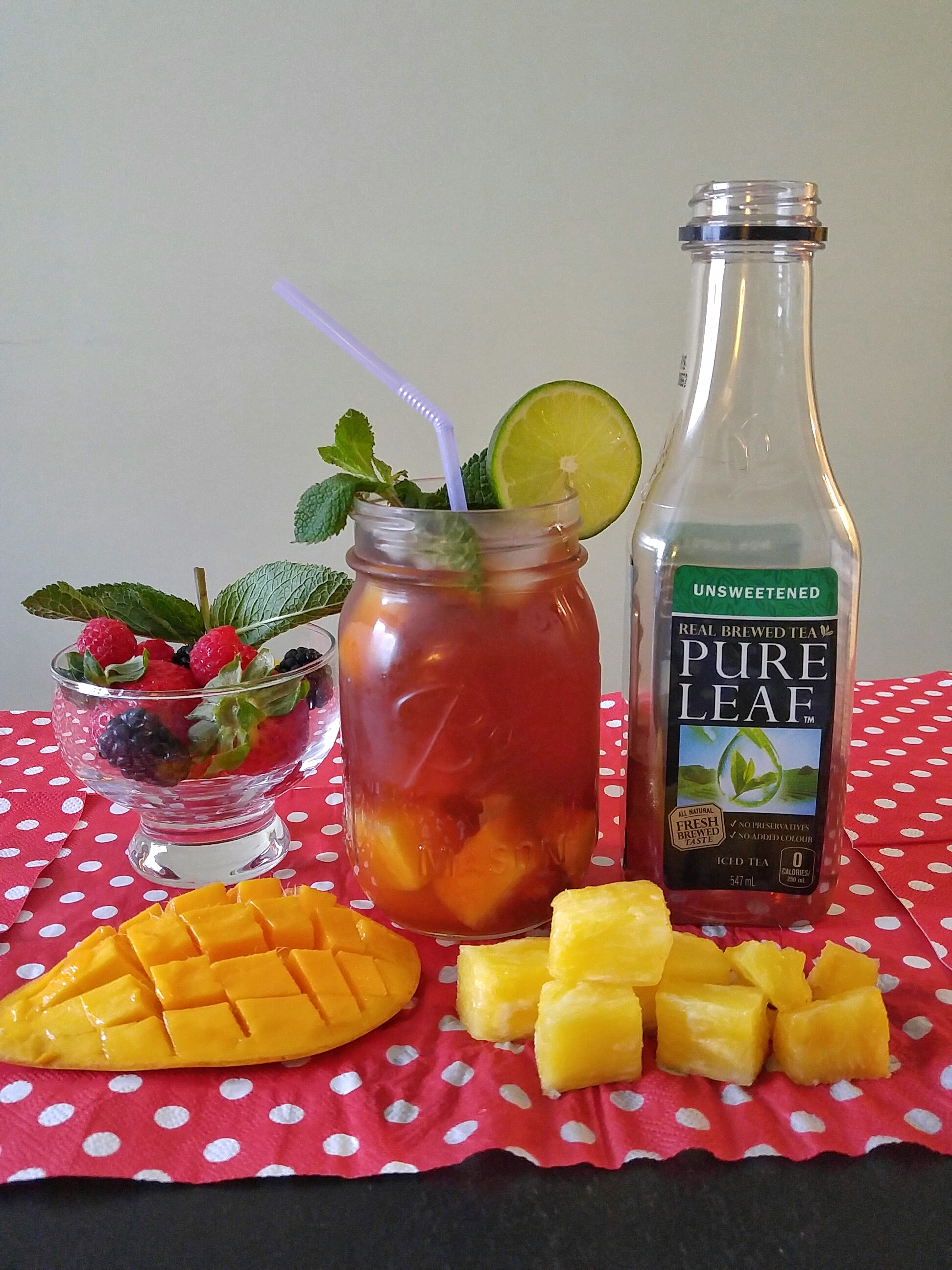 Mangoes + Pineapples mixed with Unsweetened Pure Leaf Black Tea
