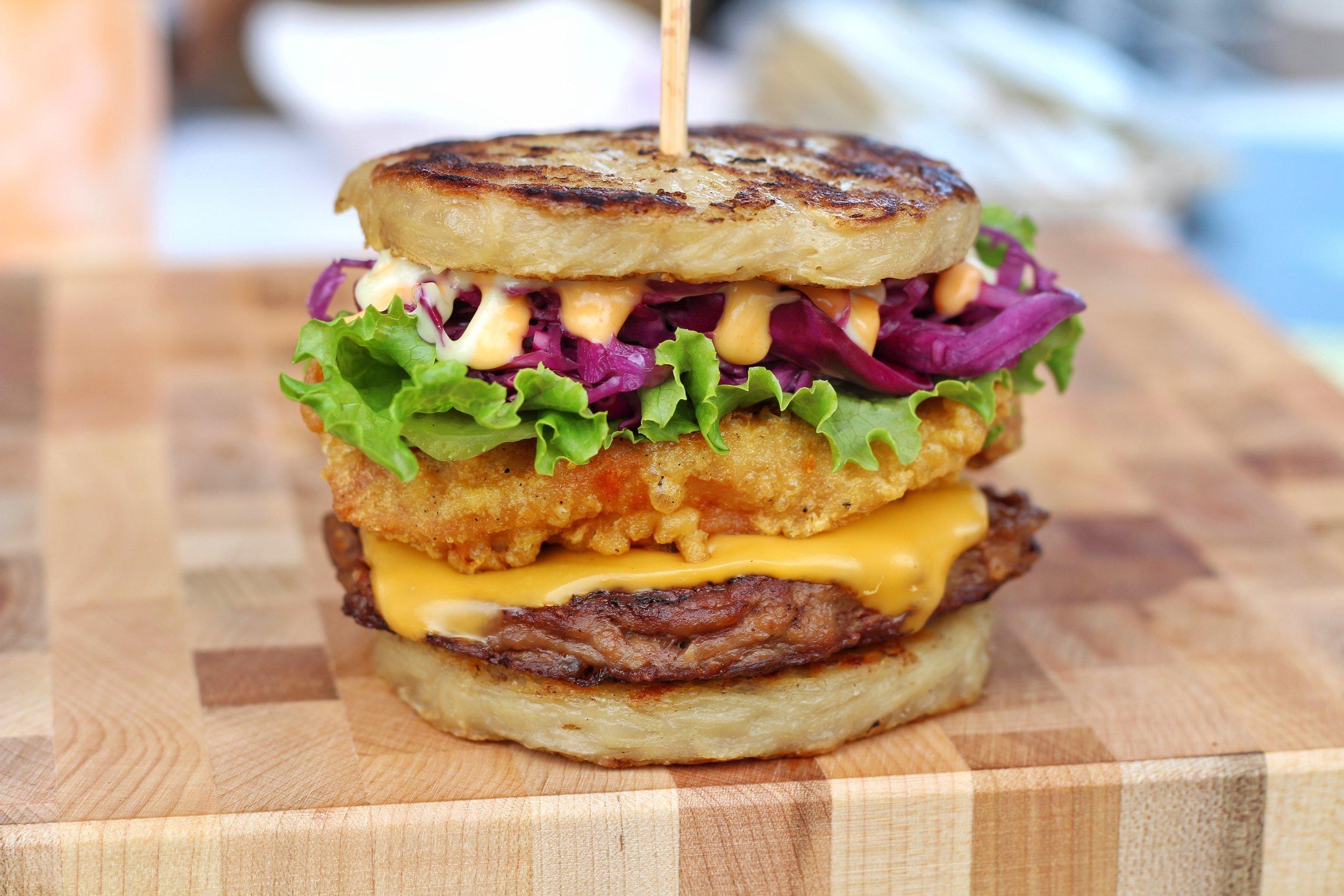 Fried chicken with a burger patty in between a ramen bun.