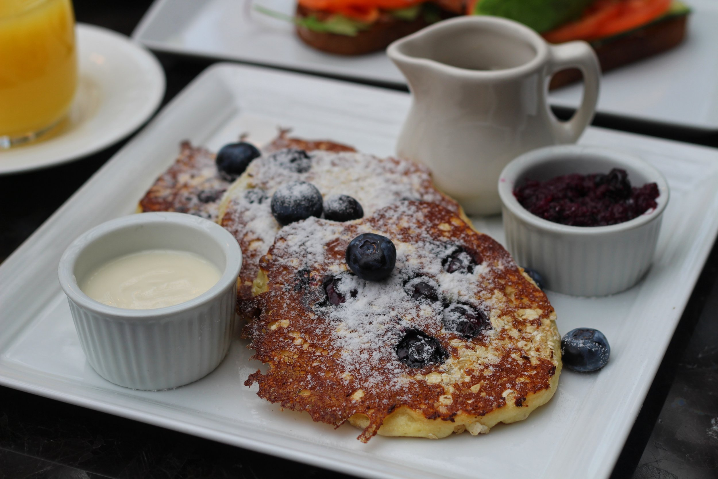 Oat & Blueberry Pancakes  - blueberries, berry compote, maple yogurt