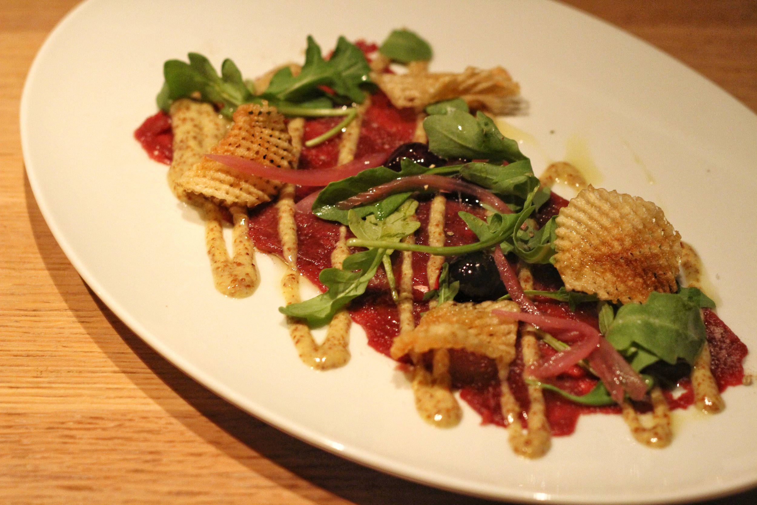 Venison Carpaccio  - spiced blueberries, arugula, grainy dressing, gaufrette potato