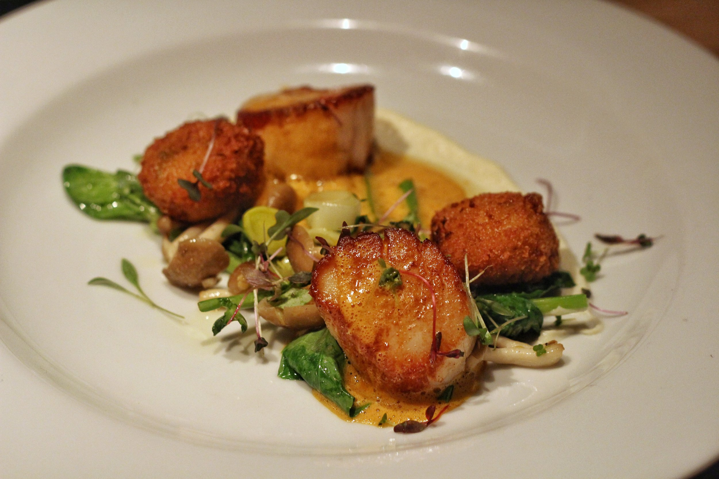 Seared Scallops  - crab potato croquettes, cauliflower puree, beech mushrooms, leeks, shellfish bisque