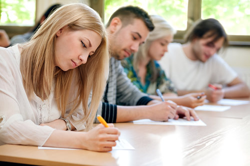 group of students takes the test in class