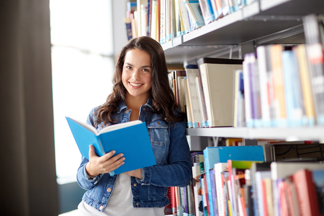 education, high school, university, learning and people concept - smiling student girl reading book