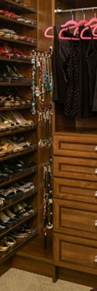 These jewelry valet rods are cleverly stored on the side of this closet panel -neat and out of the way!