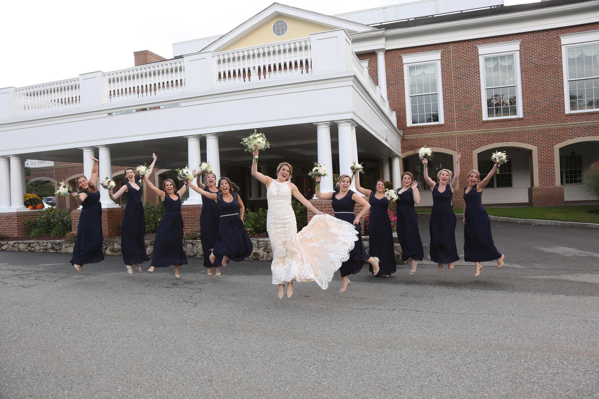 Bridesmaids jumping Destination wedding in New England
