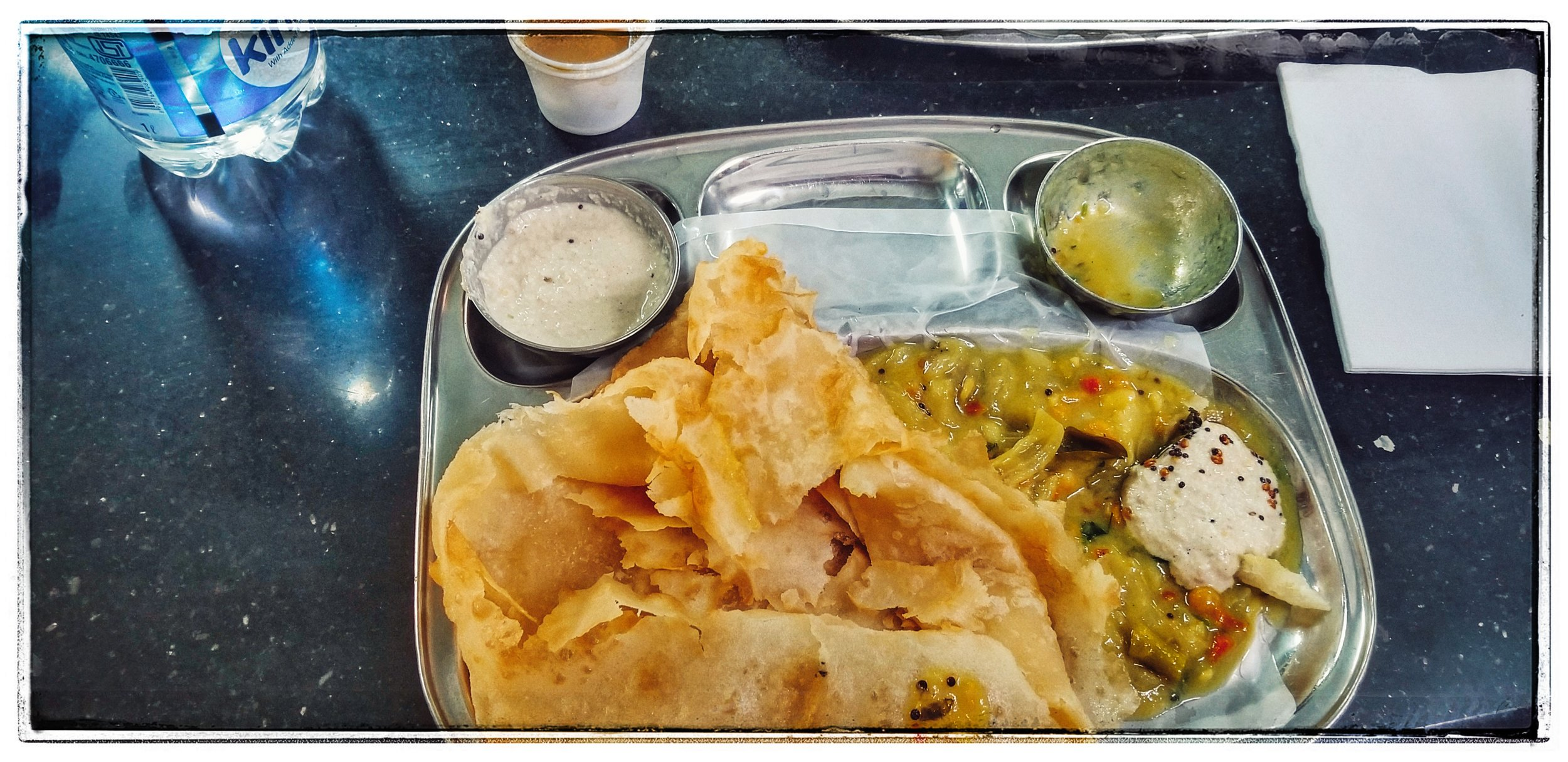 Breakfast in India I had poori, a puff pastry with curry and yogurt. With 2 coffees it cost 75 cents. . A nice dinner out? $6-$8