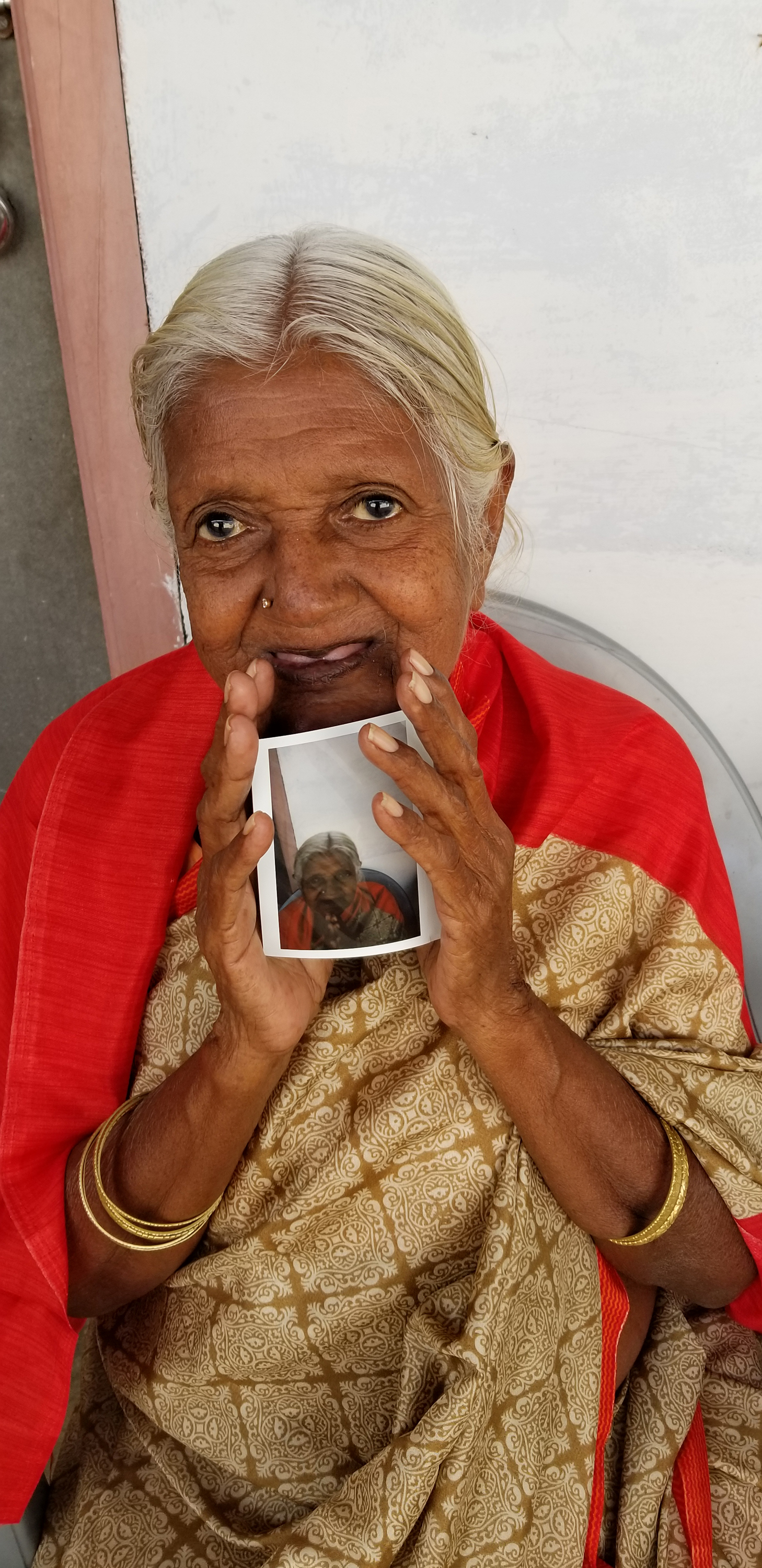 I gave Polaroids of the widows (and orphans). They loved it!