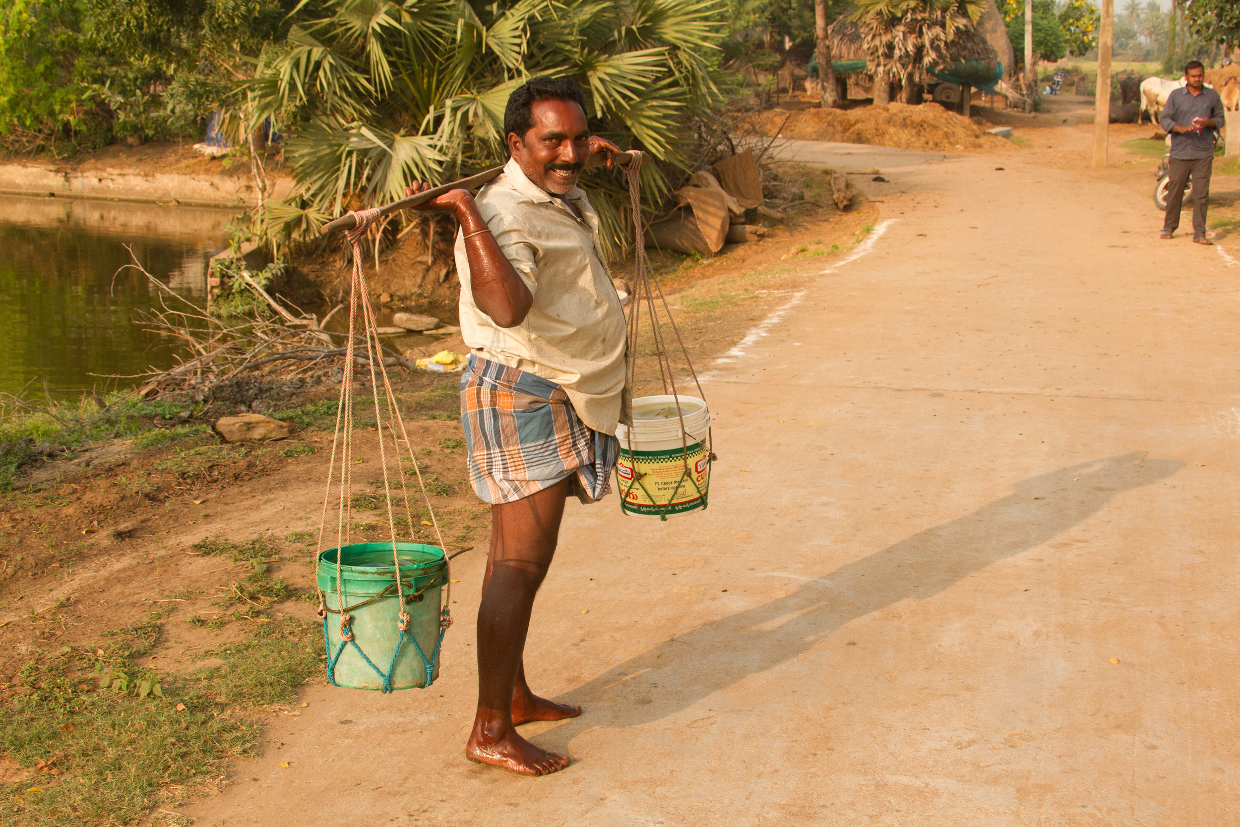 Currently, locals haul water from a polluted pond.
